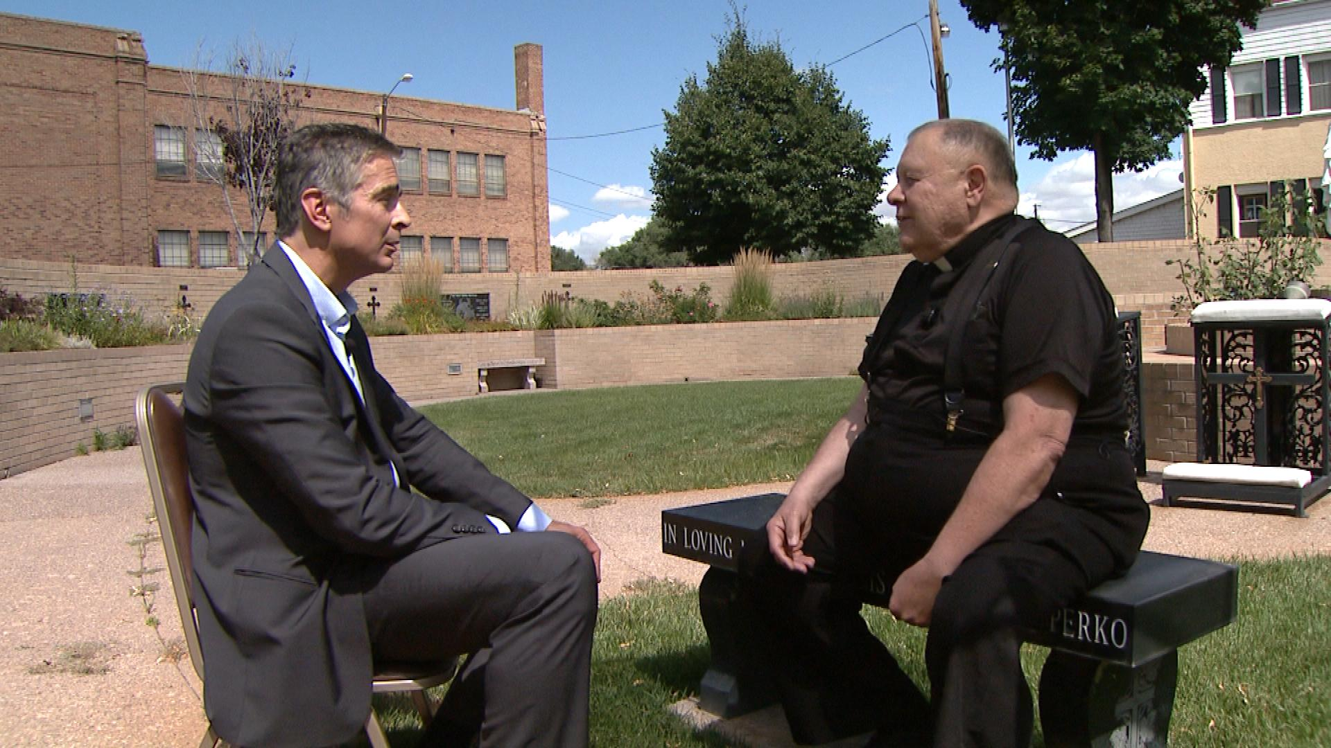CBS4's Alan Gionet talks with Father Ben Bacino (credit: CBS)