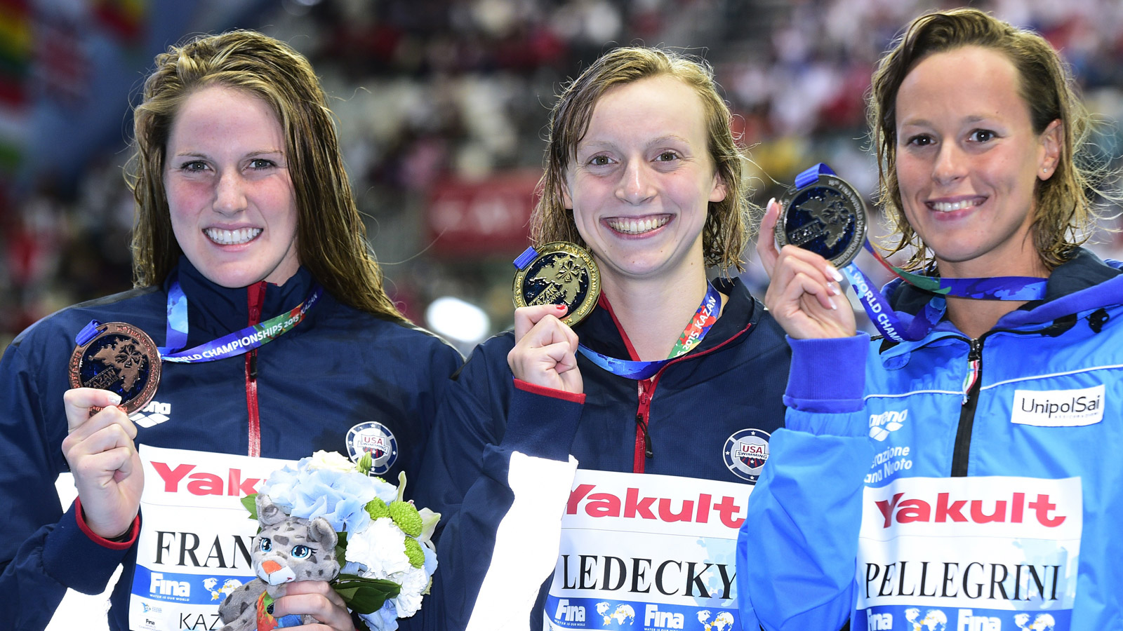 US gold medallist Katie Ledecky (C), Italy's silver medallist Federica Pellegrini (R) and US bronze medallist Missy Franklin pose on the podium of the women's 200m freestyle swimming event at the 2015 FINA World Championships in Kazan on Aug. 5, 2015. (credit: MARTIN BUREAU/AFP/Getty Images)
