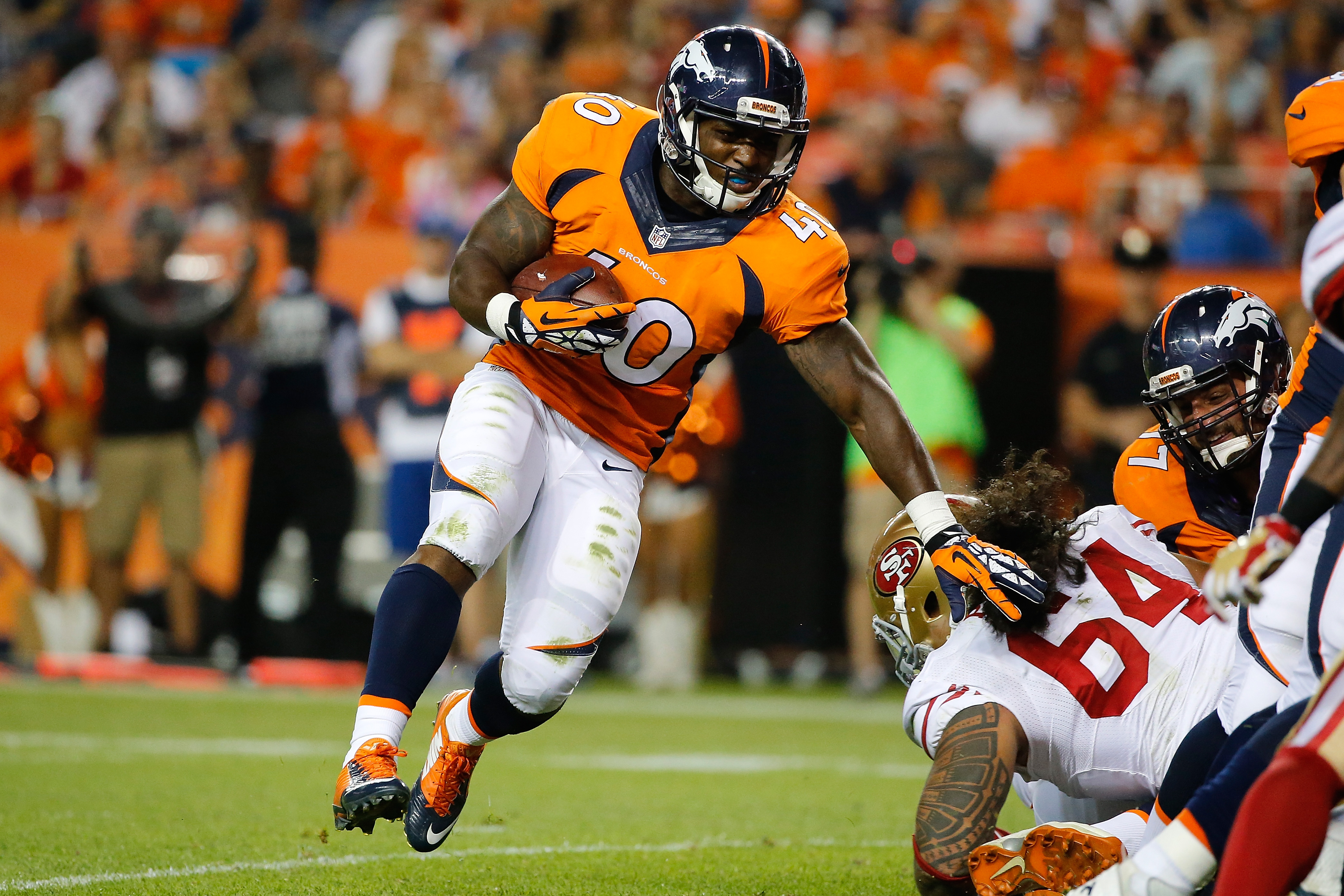Running back Juwan Thompson #40 of the Denver Broncos rushes into the endzone for a touchdown against the San Francisco 49ers during preseason action at Sports Authority Field at Mile High on August 29, 2015 in Denver, Colorado. The Broncos defeated the 49ers 19-12.  (Photo by Doug Pensinger/Getty Images)