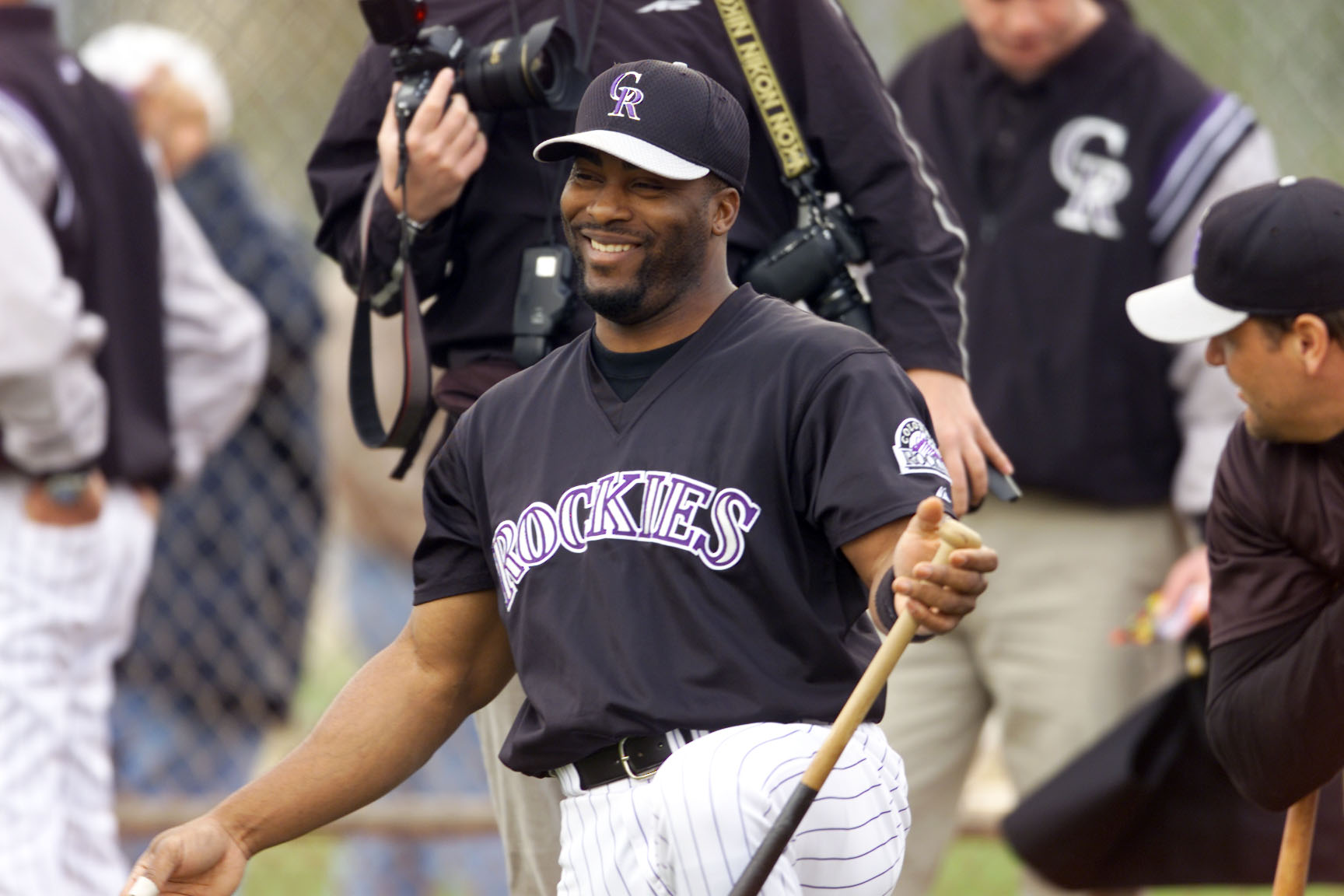 Feb. 23, 2001: Ron Gant #3 of the Colorado Rockies has a laugh during spring training at Tucson Electric Park in Tucson, Arizona. (credit: Brian Bahr/ALLSPORT/Getty Images)