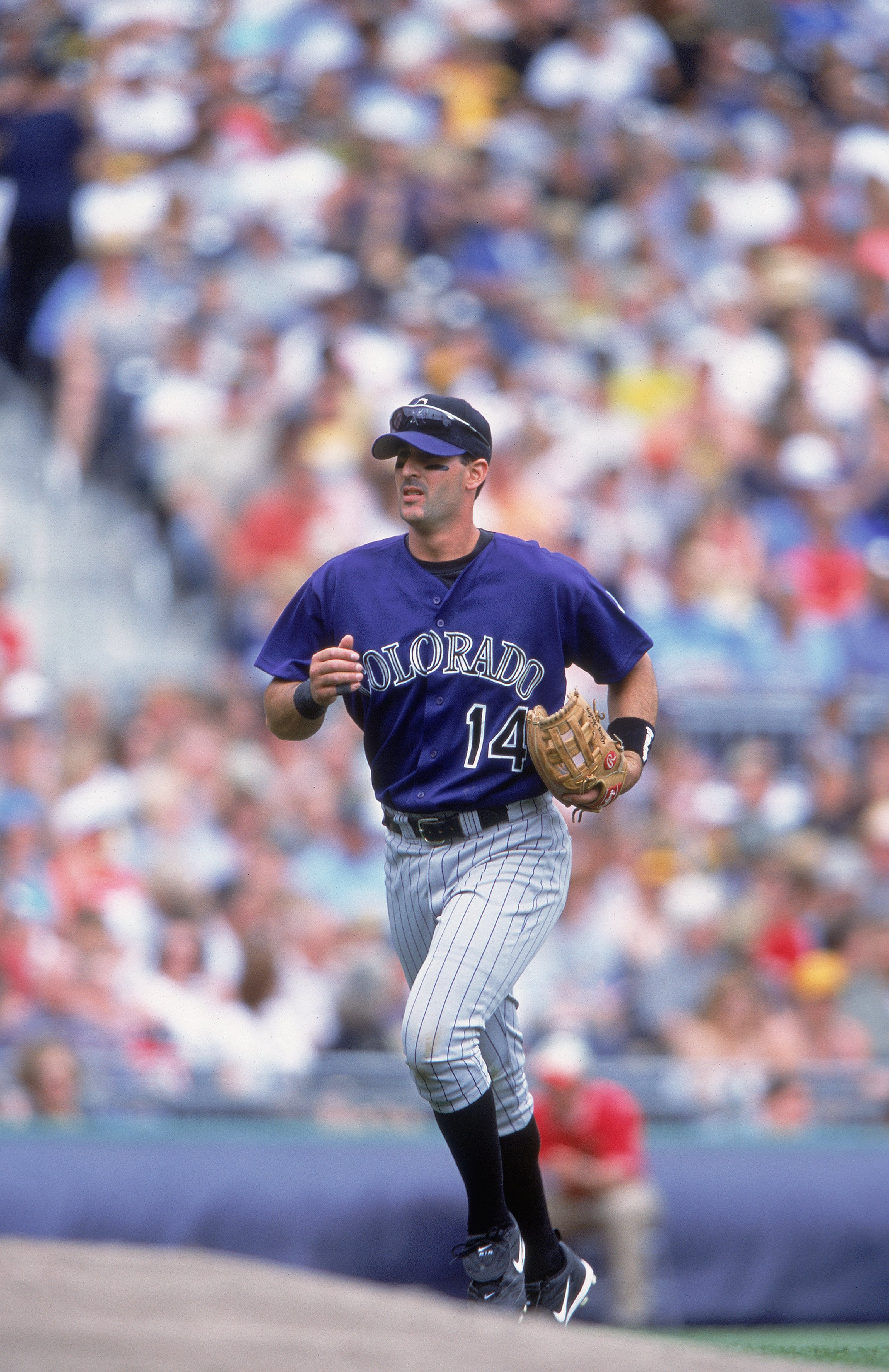 May 6, 2001: Greg Norton #14 of the Colorado Rockies jogs on the field during the game against the Pittsuburgh Pirates at PNC Park in Pittsburgh, Pennsylvania. The Pirates defeated the Rockies 4-3. (credit: Tom Pigeon/Allsport/Getty Images)