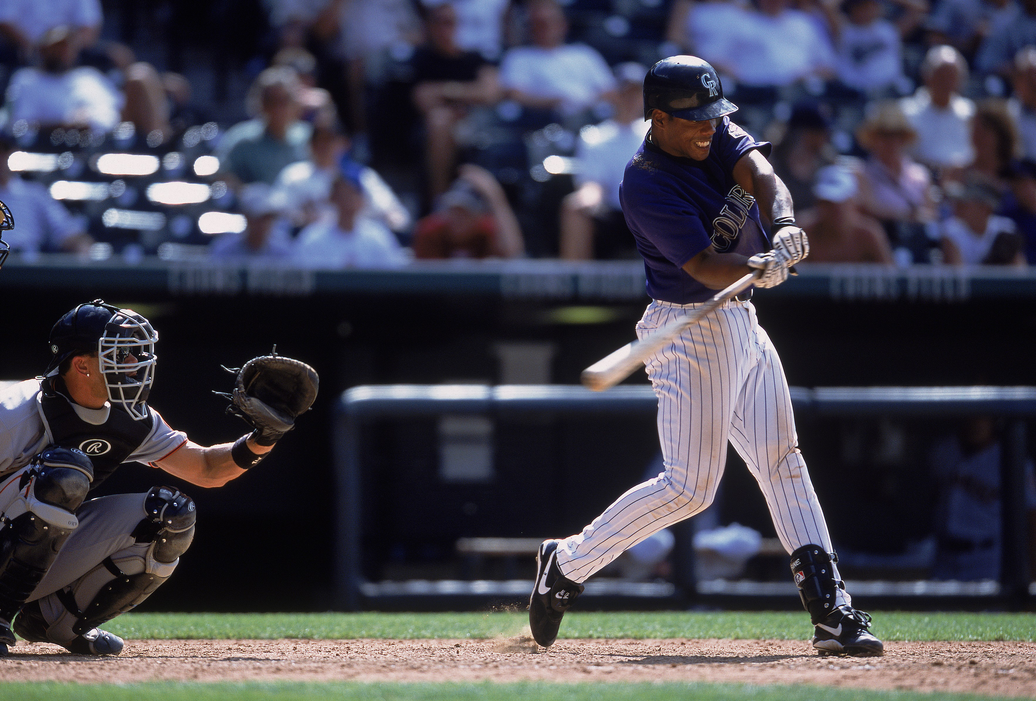 July 25, 2001: Alex Ochoa #3 of the Colorado Rockies at bat during the game against the San Francisco Giants at Coors Field in Denver, Colorado. The Giants defeated the Rockies 9-3.(credit: Brian Bahr/Allsport/Getty Images)