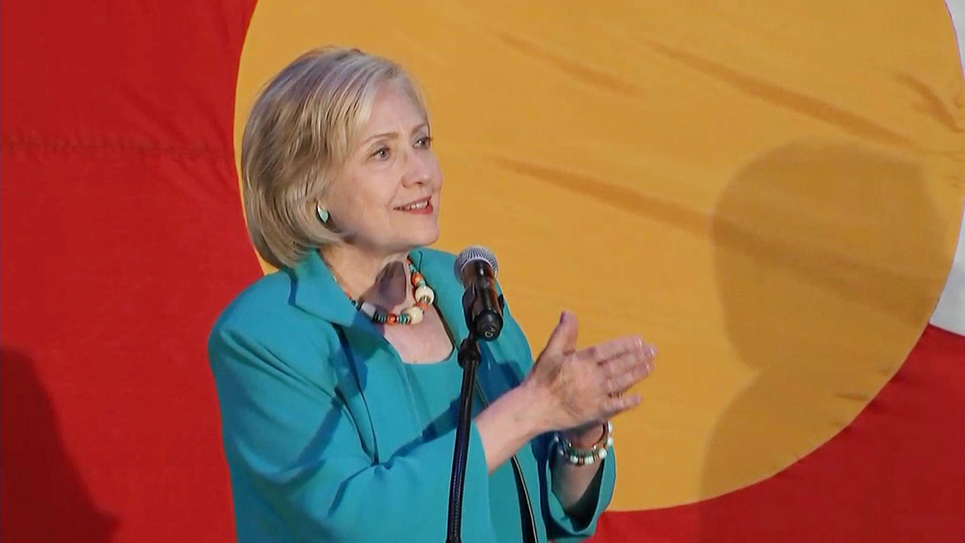 Hillary Clinton in front of the Colorado state flag in Denver on Aug. 4 (credit: CBS)