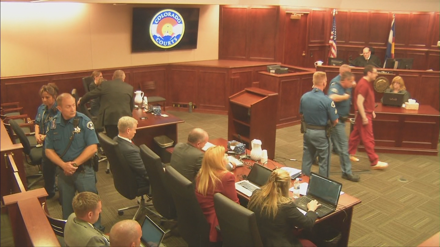 Aurora theater gunman James Holmes escorted out of court on Wednesday (credit: CBS)