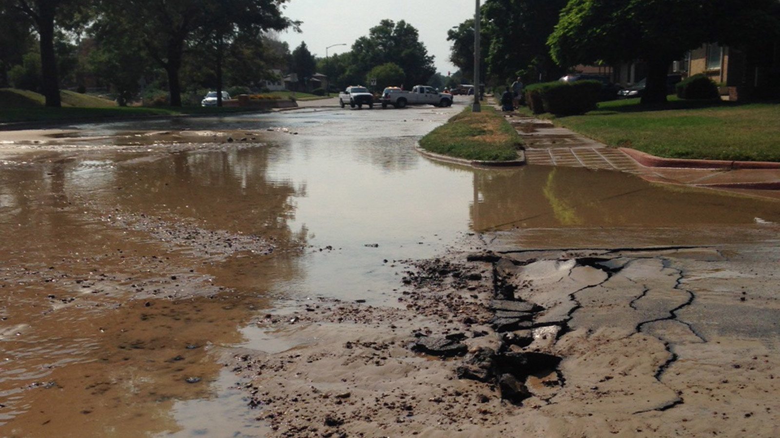 A water main break at MLK Blvd. and Jasmine on Friday afternoon (credit: CBS)