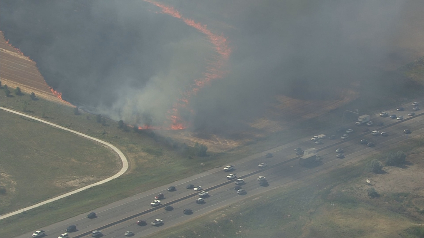 Copter4 flew over a fire burning at I-25 and E-470 on Tuesday (credit: CBS)
