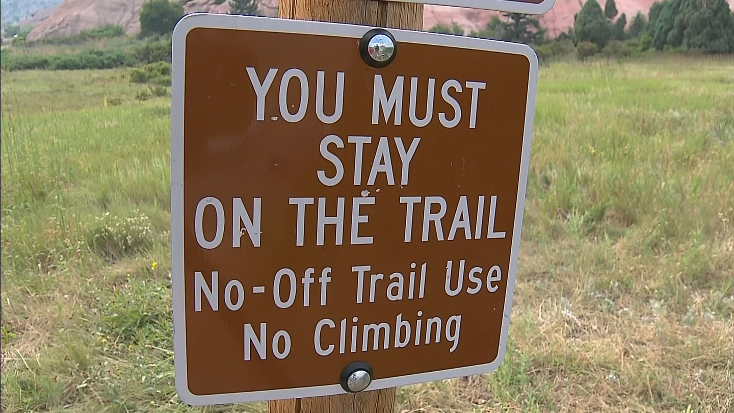 Signs posted warn of no climbing on rocks (credit: CBS)