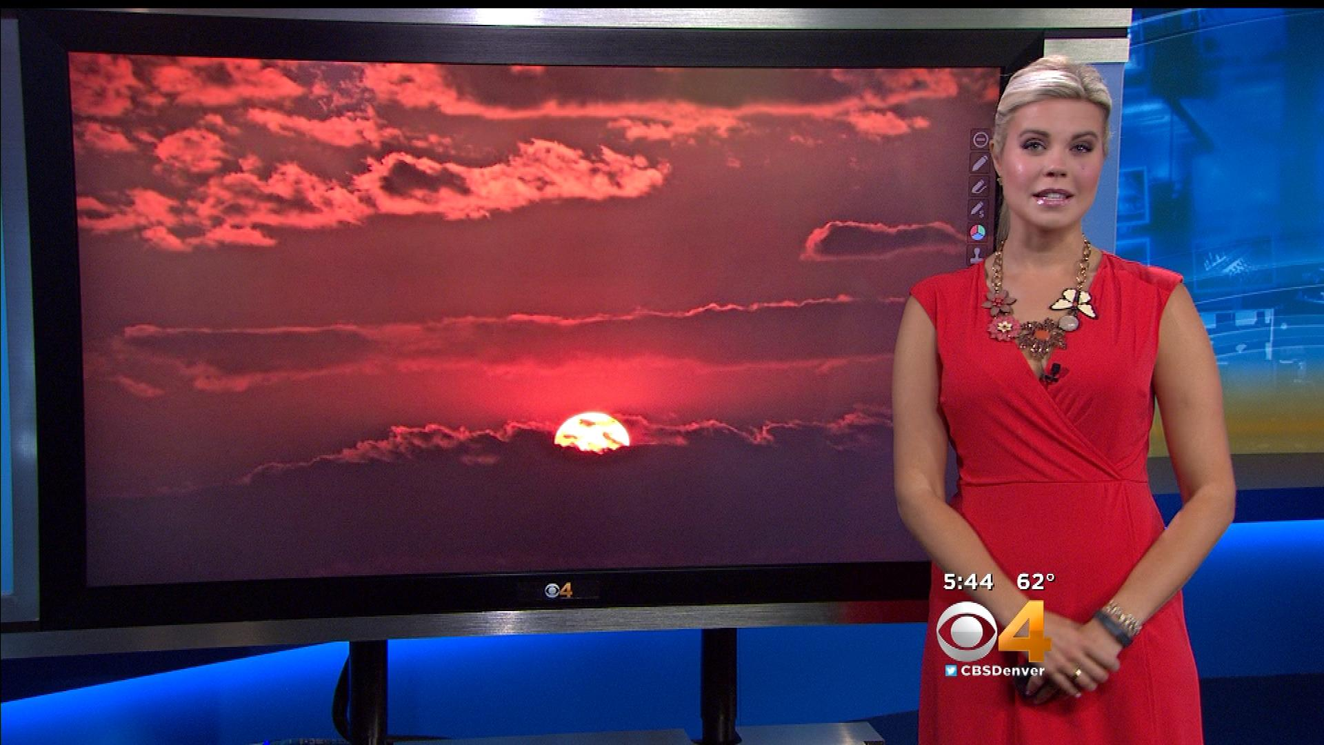 CBS4's Lauren Whitney shows a photo of the sunset on Thursday night, taken by YouReporter Michael Smith (credit: CBS)