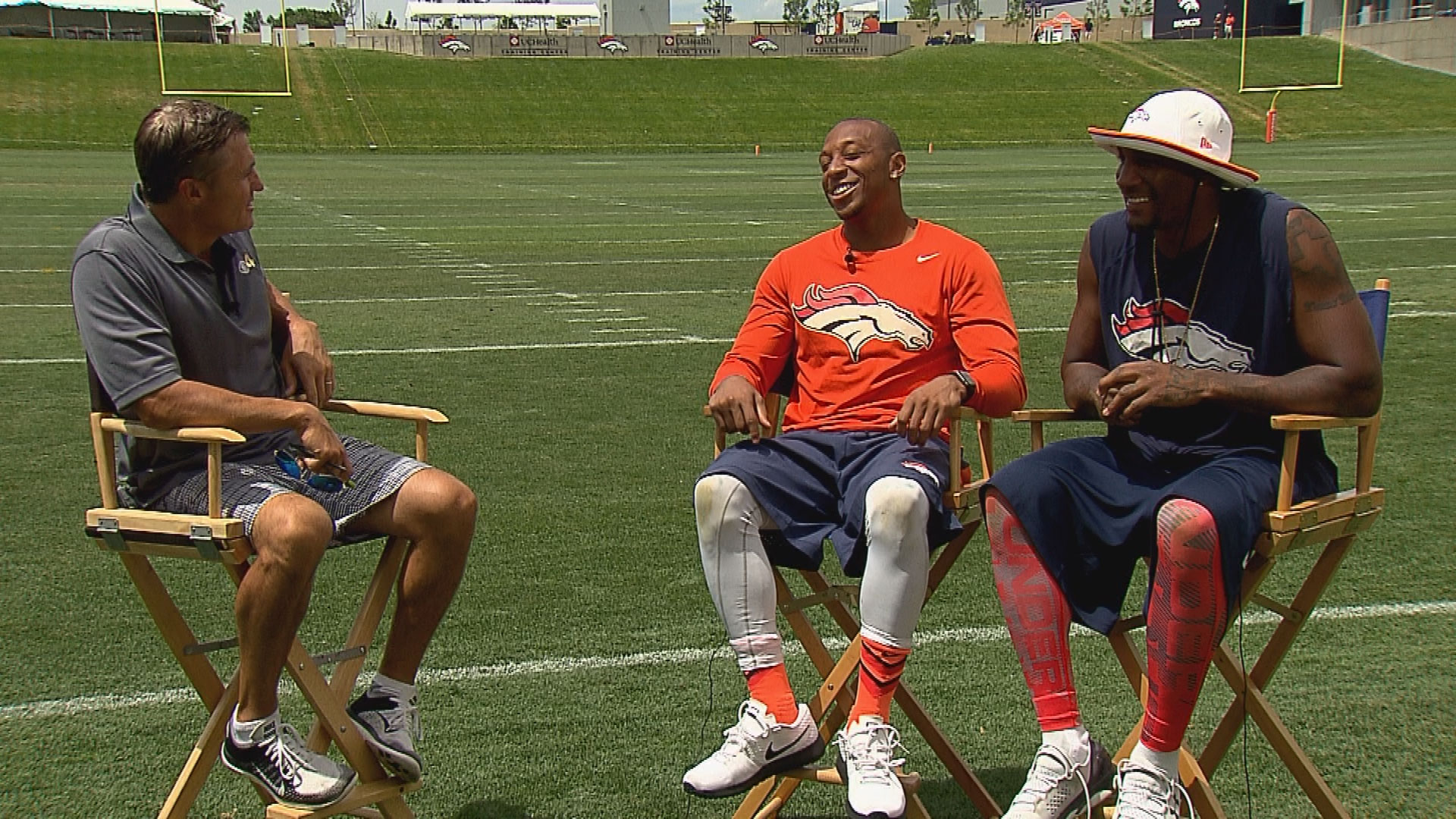CBS4's Vic Lombardi with Chris Harris and Aqib Talib on Thursday (credit: Brian Madden)