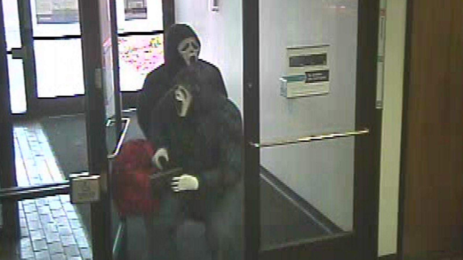 The bank robbery suspects walking into the US Bank at 1415 Carr Street (credit: FBI)