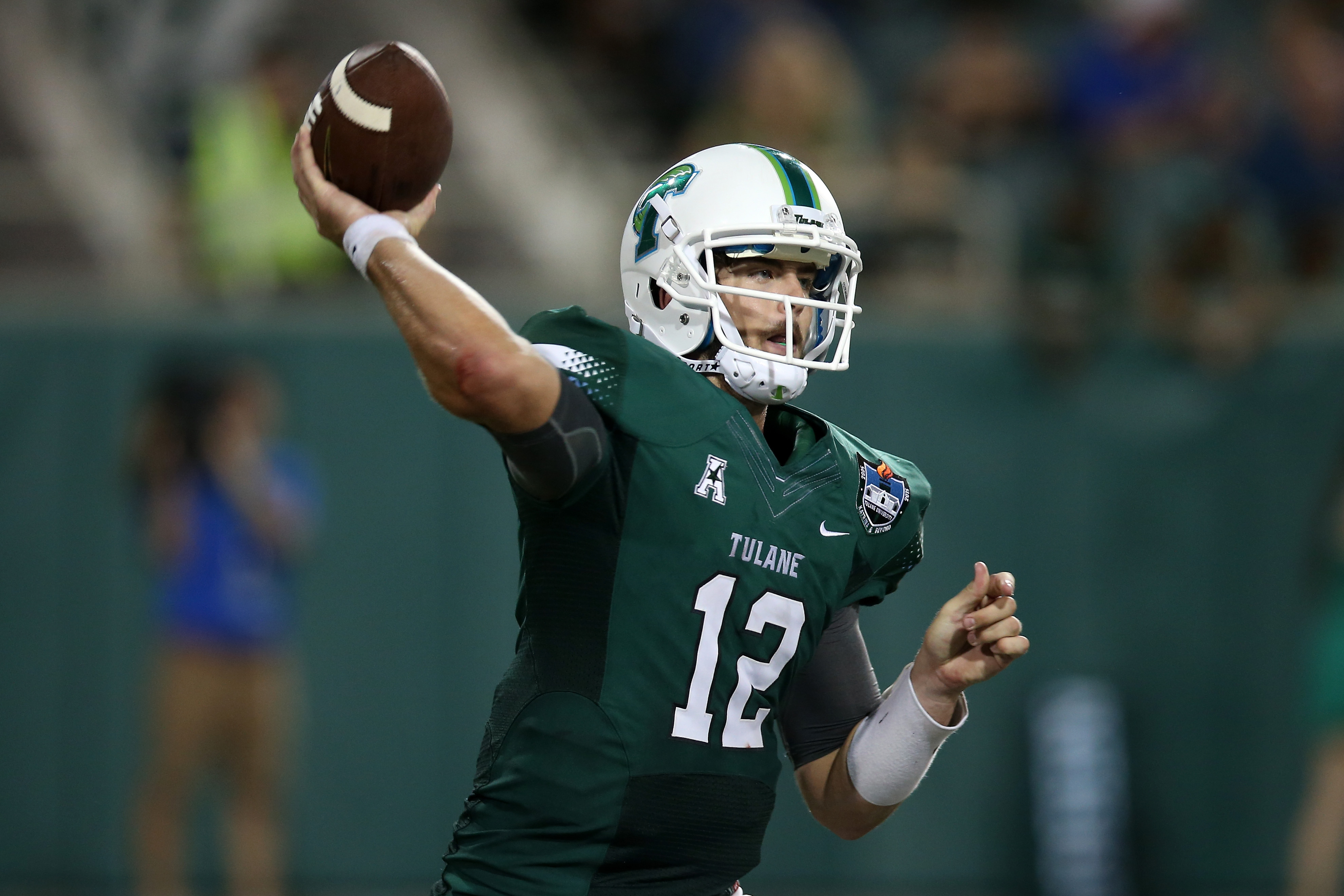 NEW ORLEANS, LA - SEPTEMBER 03: Tanner Lee #12 of the Tulane Green Wave throws under pressure from Duke Blue Devils at Yulman Stadium on September 3, 2015 in New Orleans, Louisiana. (Photo by Chris Graythen/Getty Images)