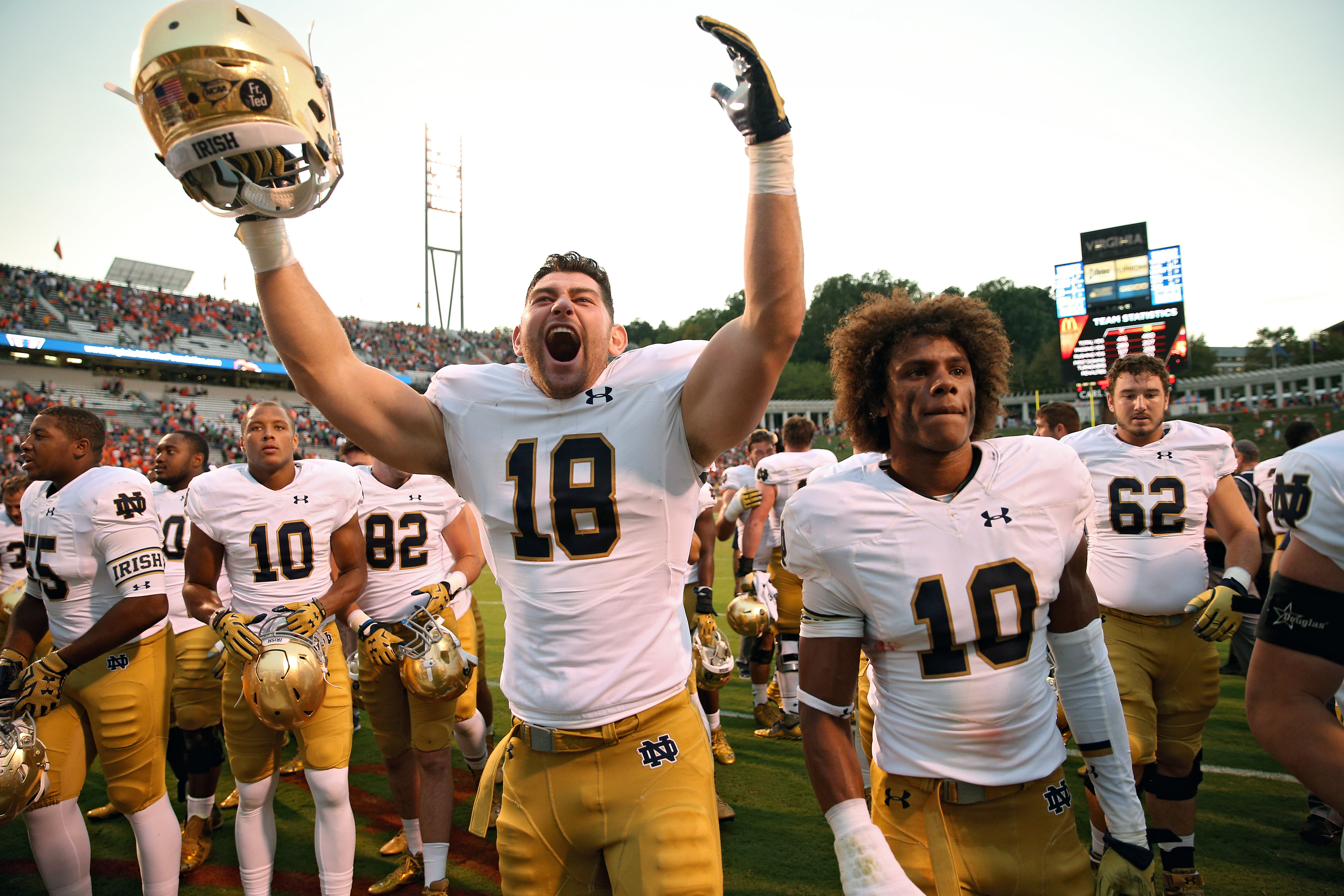 CHARLOTTESVILLE, VA - SEPTEMBER 12: Chase Hounshell #18 of the Notre Dame Fighting Irish and teammates celebrate after defeating the Virginia Cavaliers at Scott Stadium on September 12, 2015 in Charlottesville, Virginia. The Notre Dame Fighting Irish won, 34-27. (Photo by Patrick Smith/Getty Images)