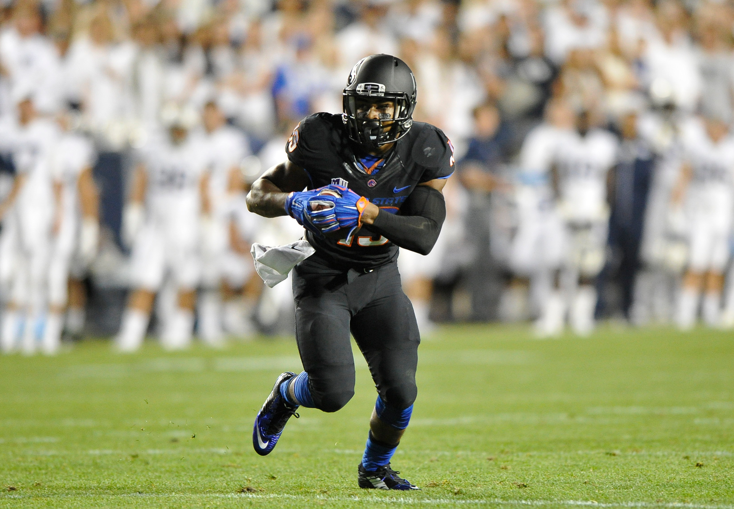 PROVO, UT - SEPTEMBER 12: Jeremy McNichols #13 of the Boise State Broncos runs with the ball during their game against the Brigham Young Cougars at LaVell Edwards Stadium on September 12, 2015 in Provo, Utah. (Photo by Gene Sweeney Jr/Getty Images)