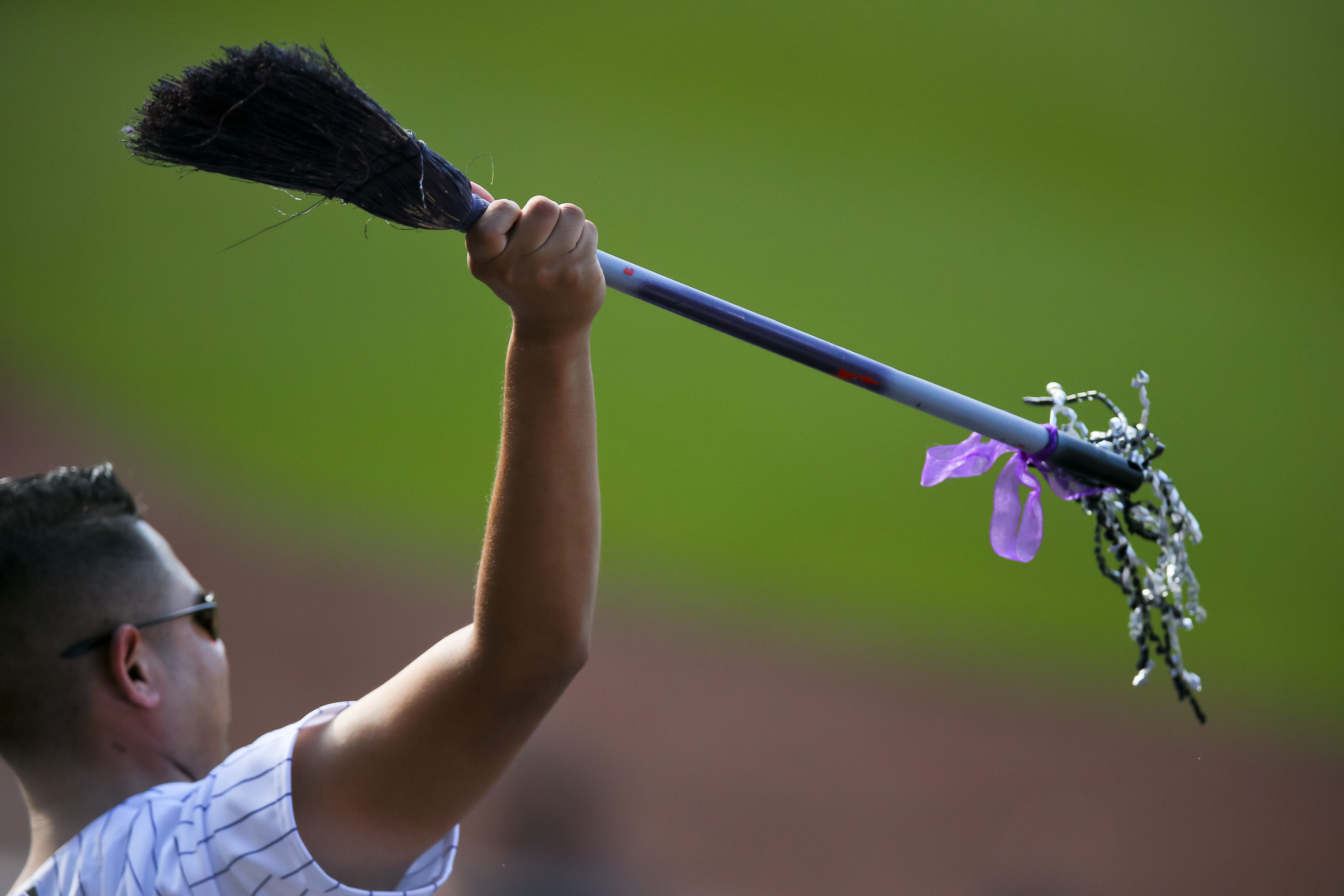 A Colorado Rockies fan cheers with a broom as his team went on to sweep the three game series with the Los Angeles Dodgers after defeating them 12-5 at Coors Field on Sept. 27, 2015. (Photo by Justin Edmonds/Getty Images)
