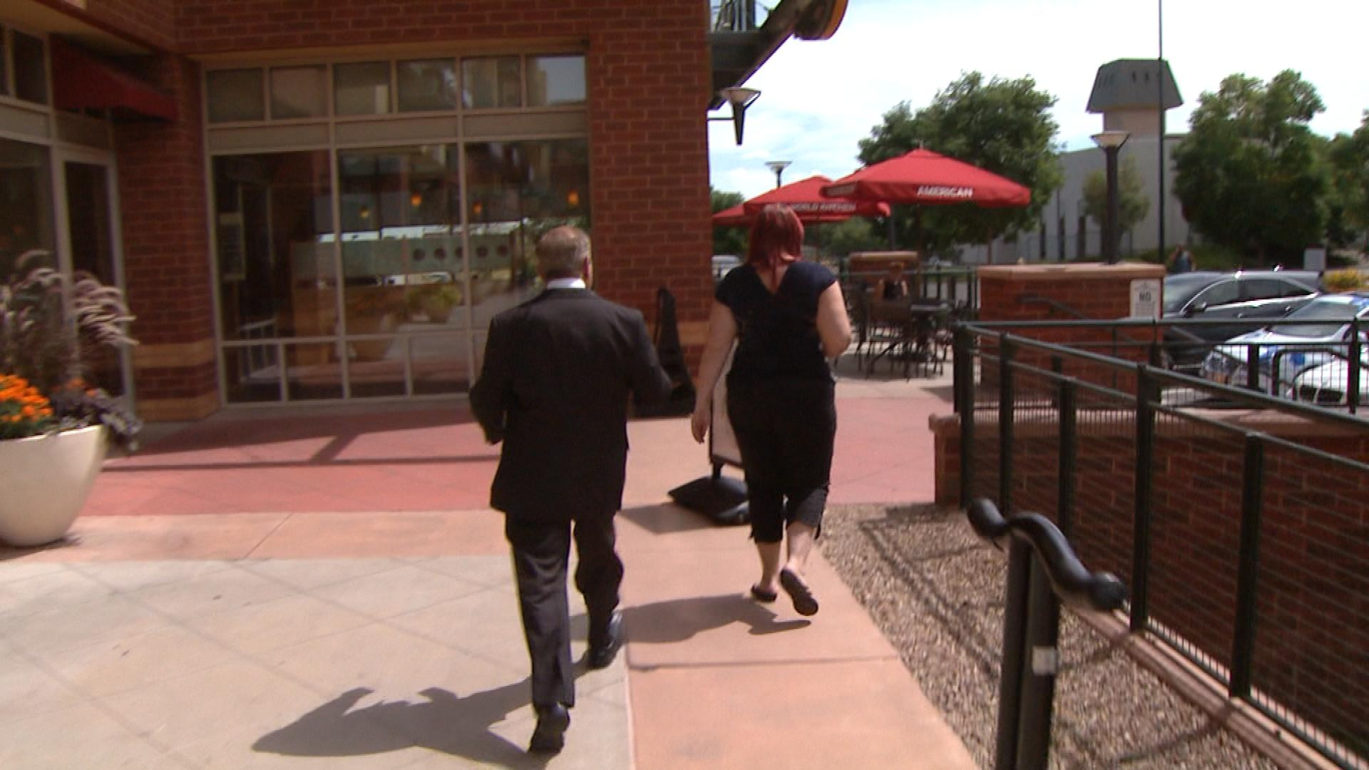 CBS4 Investigator Rick Sallinger confronting the woman from Martha Stoner (credit: CBS)