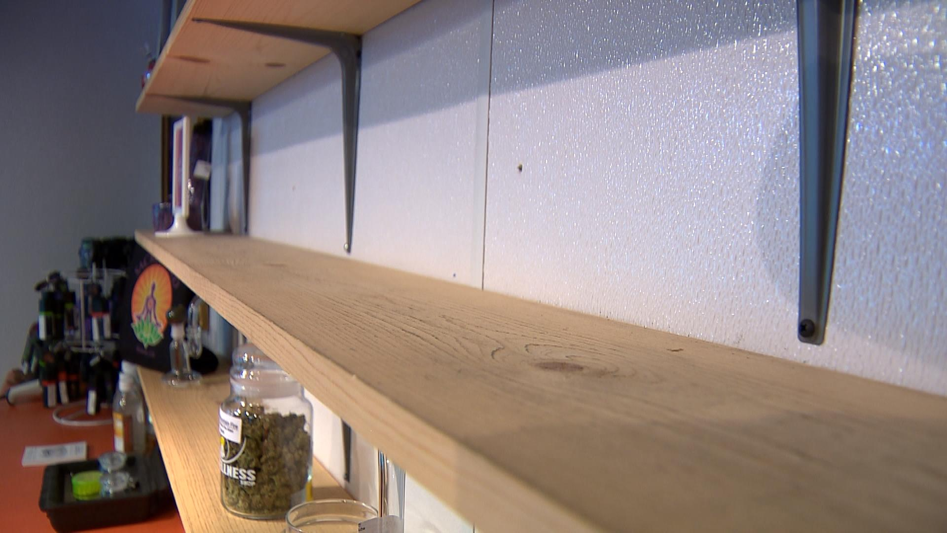 Empty shelves at Sacred Seed (credit: CBS)