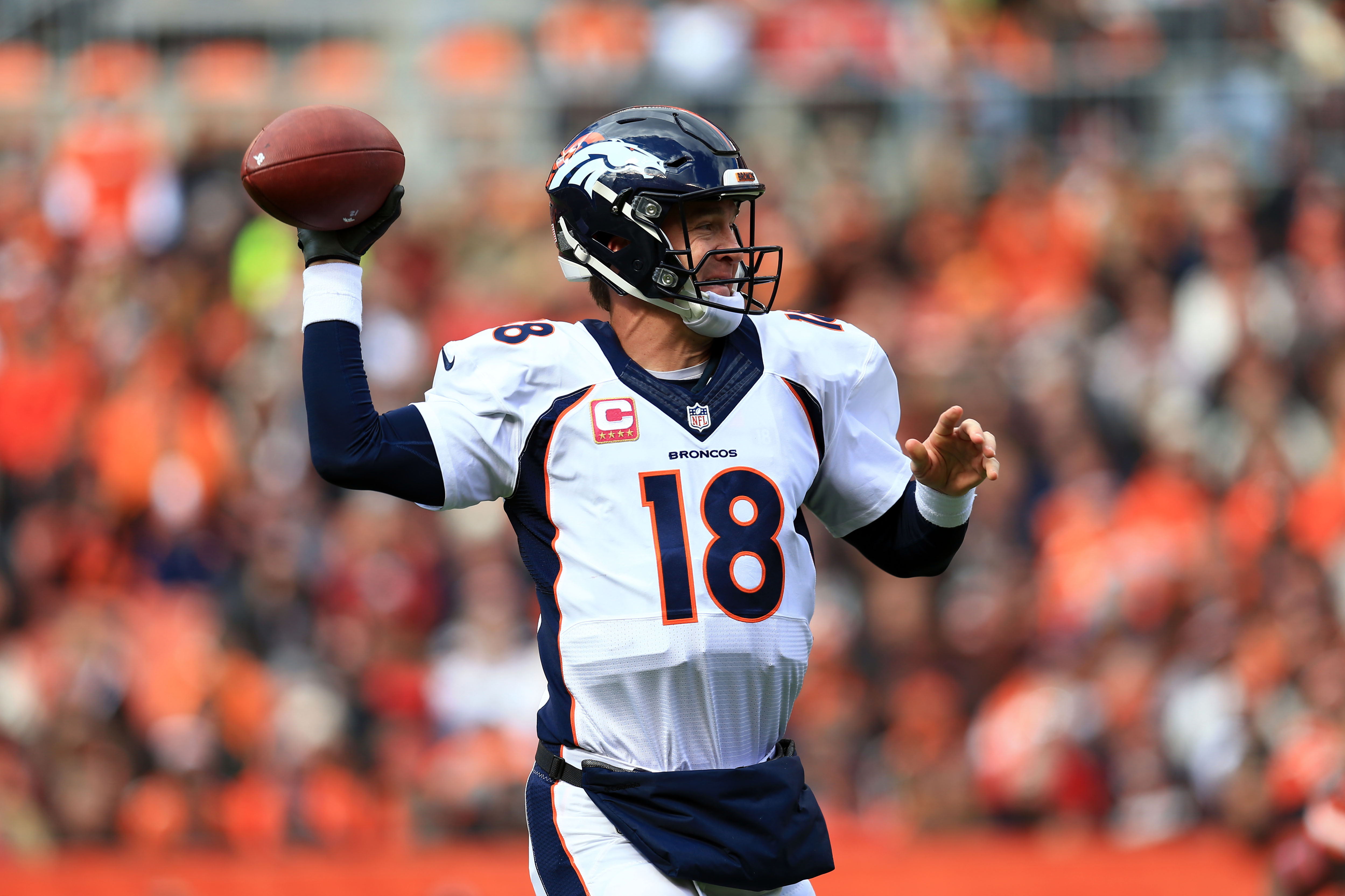 CLEVELAND, OH - OCTOBER 18: Quarterback Peyton Manning #18 of the Denver Broncos throws a pass during the first quarter against the Cleveland Browns at Cleveland Browns Stadium on October 18, 2015 in Cleveland, Ohio. (Photo by Andrew Weber/Getty Images)