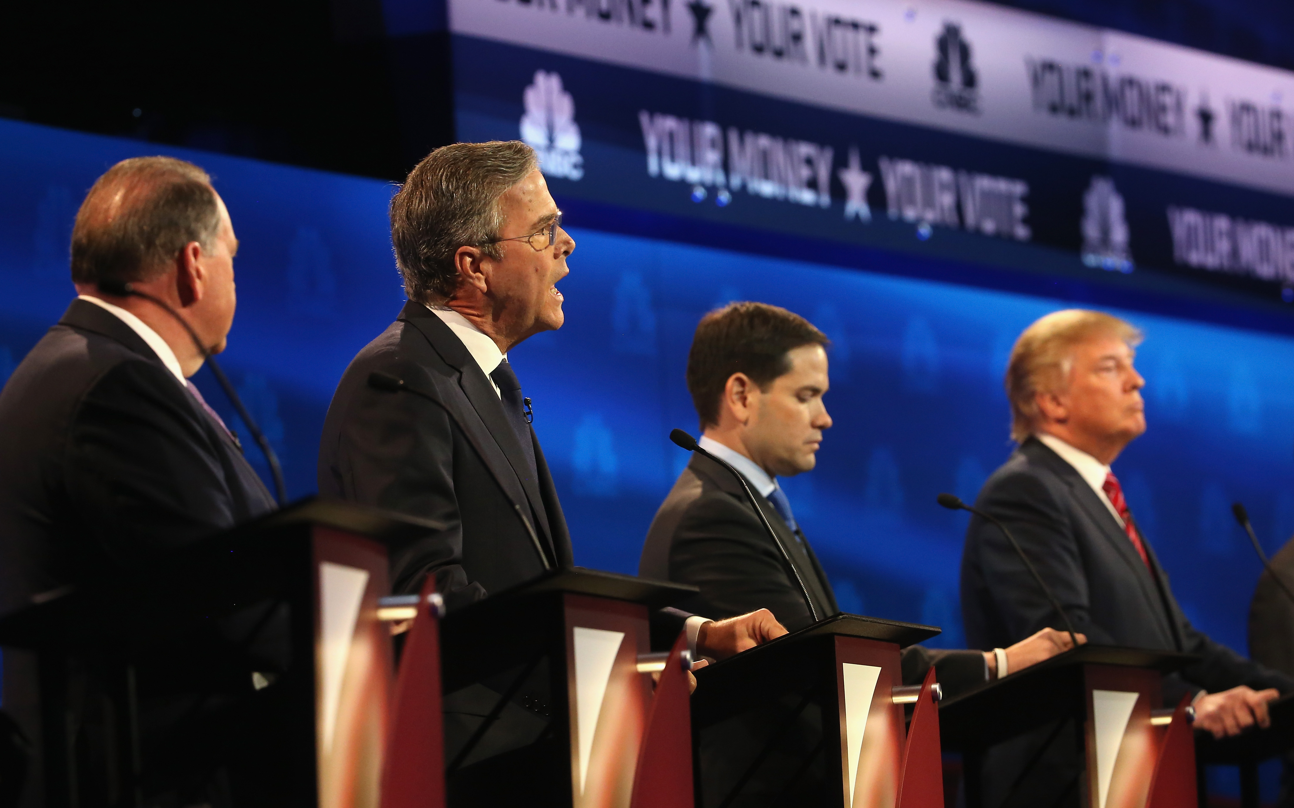 Presidential candidate Jeb Bush (2nd L) speaks while Sen. Marco Rubio (R-FL),  Donald Trump, and Mike Huckabee (L) look on during the CNBC Republican Presidential Debate at University of Colorados Coors Events Center October 28, 2015 in Boulder, Colorado.  Fourteen Republican presidential candidates are participating in the third set of Republican presidential debates.  (Photo by Justin Sullivan/Getty Images)