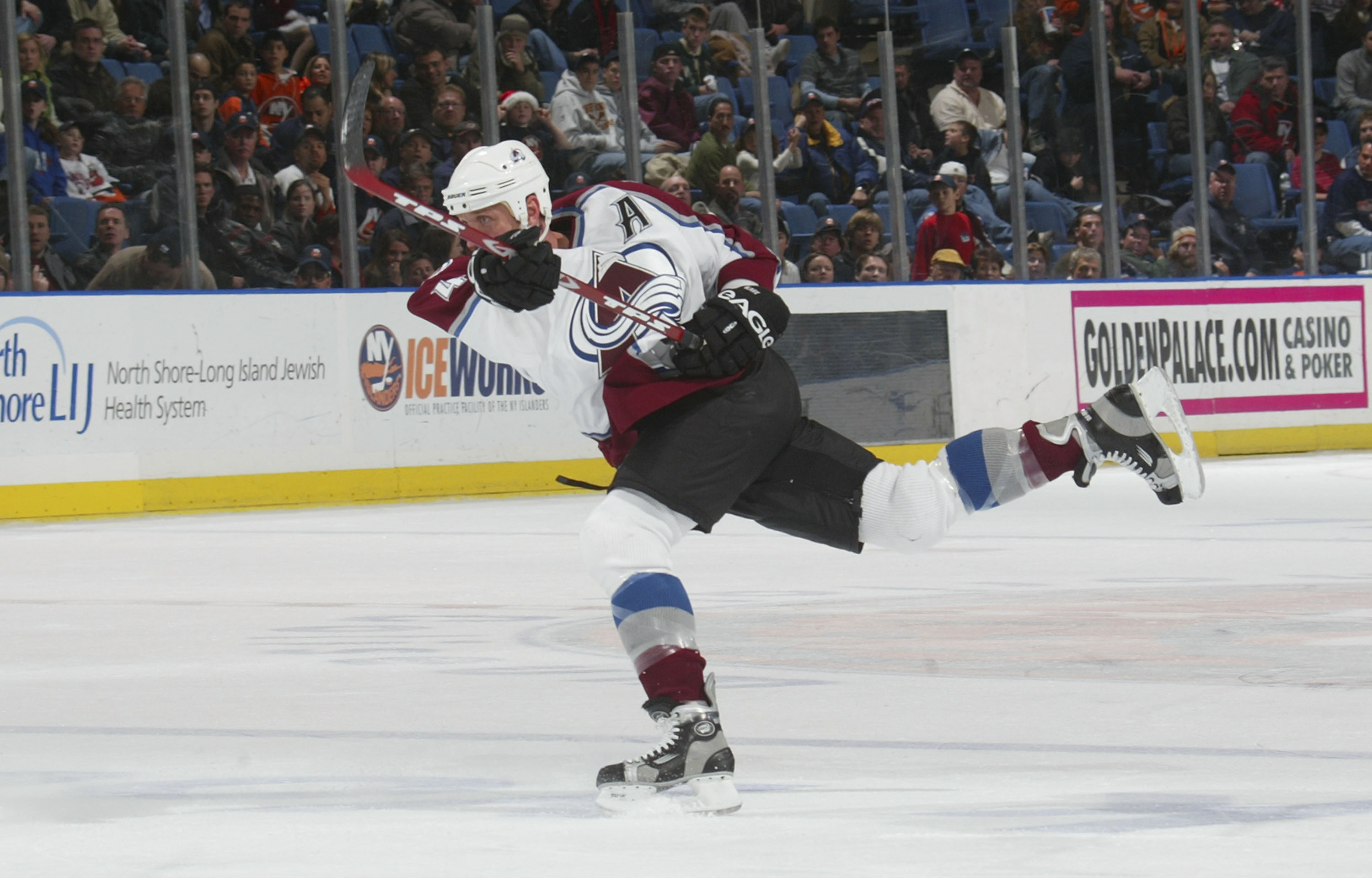 Rob Blake #4 of the Colorado Avalanche fires a shot from the point against the New York Islanders at the Nassau Coliseum on December 17, 2005 in Uniondale, New York. The Isles defeated the Avalanche 5-4. (Photo by Bruce Bennett/Getty Images)