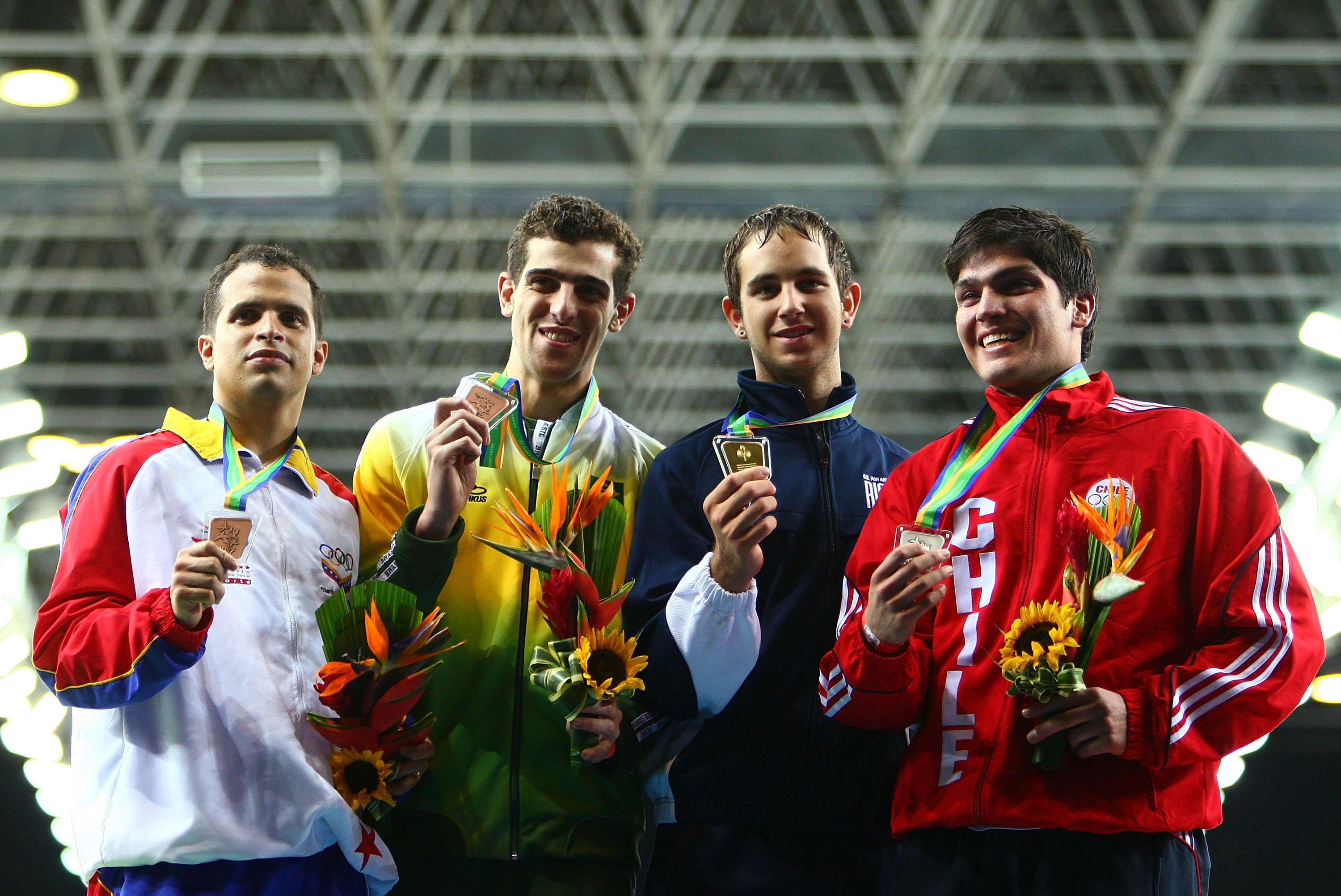 (L-R) Carlos Rodriguez of Venezuela (bronze), Jodo Suoza of Brazil (bronze), Andras Horanyi of the United States of America (gold) and Felipe Alvear of Chile (silver) celebrate after the Men's Individual Foil final during the XV Pan American Games on July 14, 2007 at Copacabana Beach in Rio De Janeiro, Brazil.  (Photo by Donald Miralle/Getty Images)