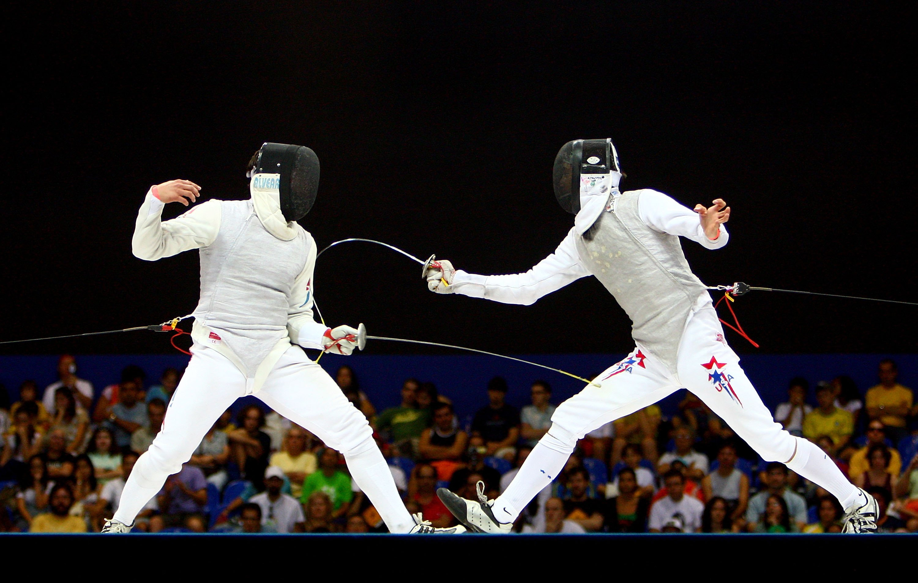 Andras Horanyi of the United States of America (R) and Felipe Alvear of Chile compete in the Men's Individual Foil final during the XV Pan American Games on July 14, 2007 at Copacabana Beach in Rio De Janeiro, Brazil.  (Photo by Donald Miralle/Getty Images)