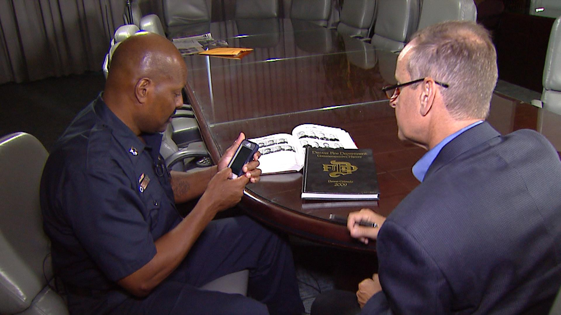Harold Johnson shows the text message to CBS4's Brian Maass (credit: CBS)