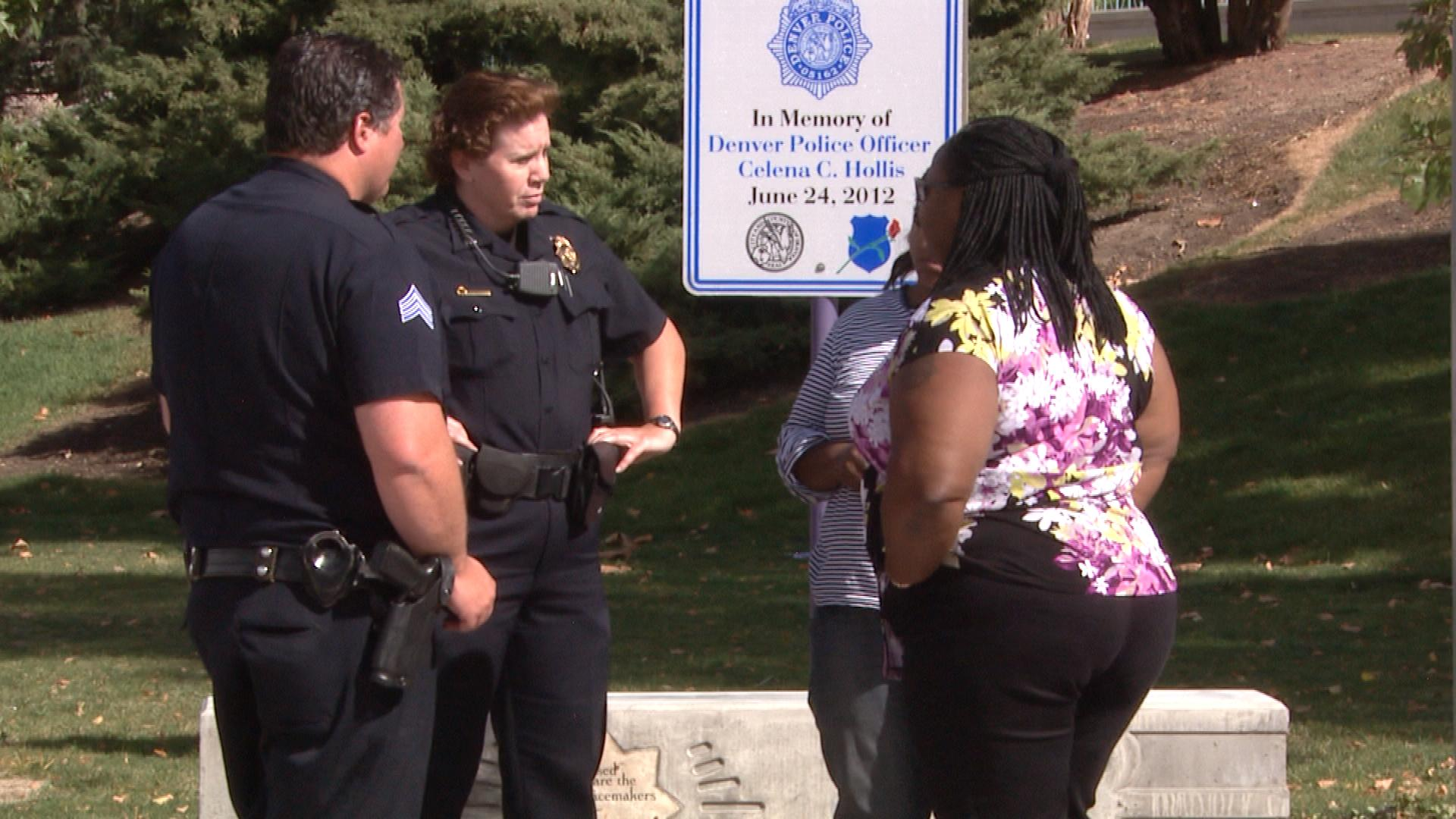 Celena Hollis' mother and sister talk with police officers at the defaced memorial (credit: CBS)