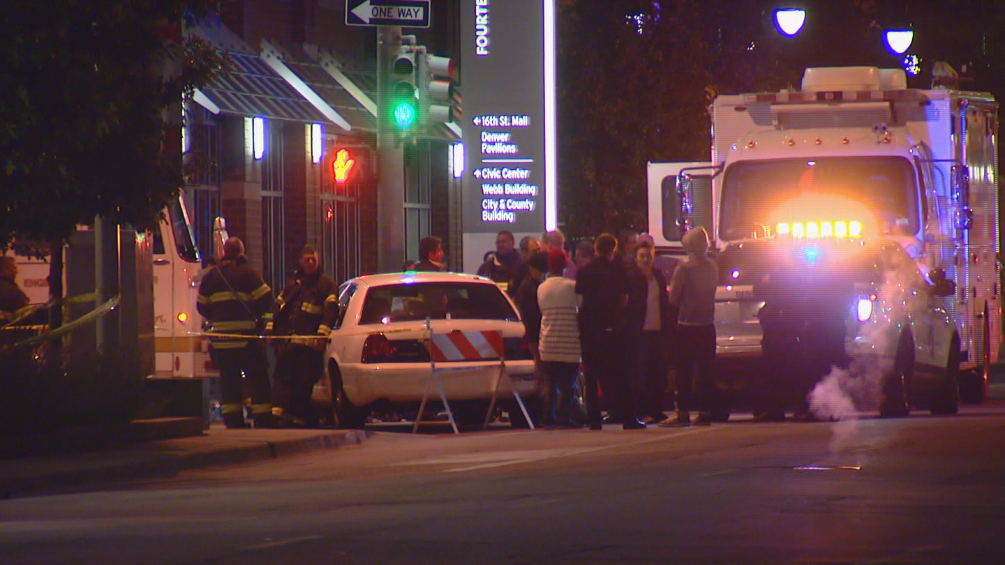 Guests of the Hyatt Regency spill into the street early Saturday (credit: CBS)