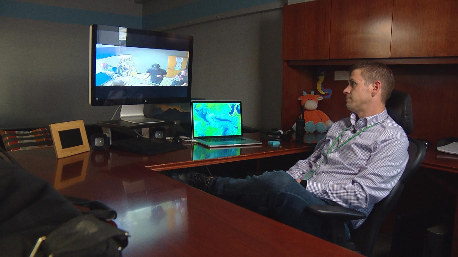 Ryan Fowler, president and owner of Redeye Releaf Shop, watches video of his employees selling to an underage customer (credit: CBS)