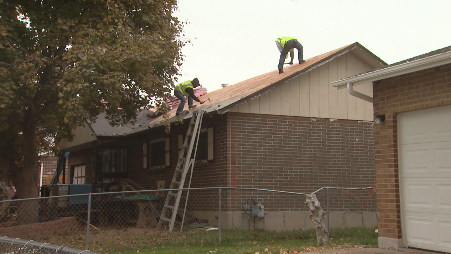 Mary Navvaro's home gets a new roof from Apollo Roofing (credit: CBS)