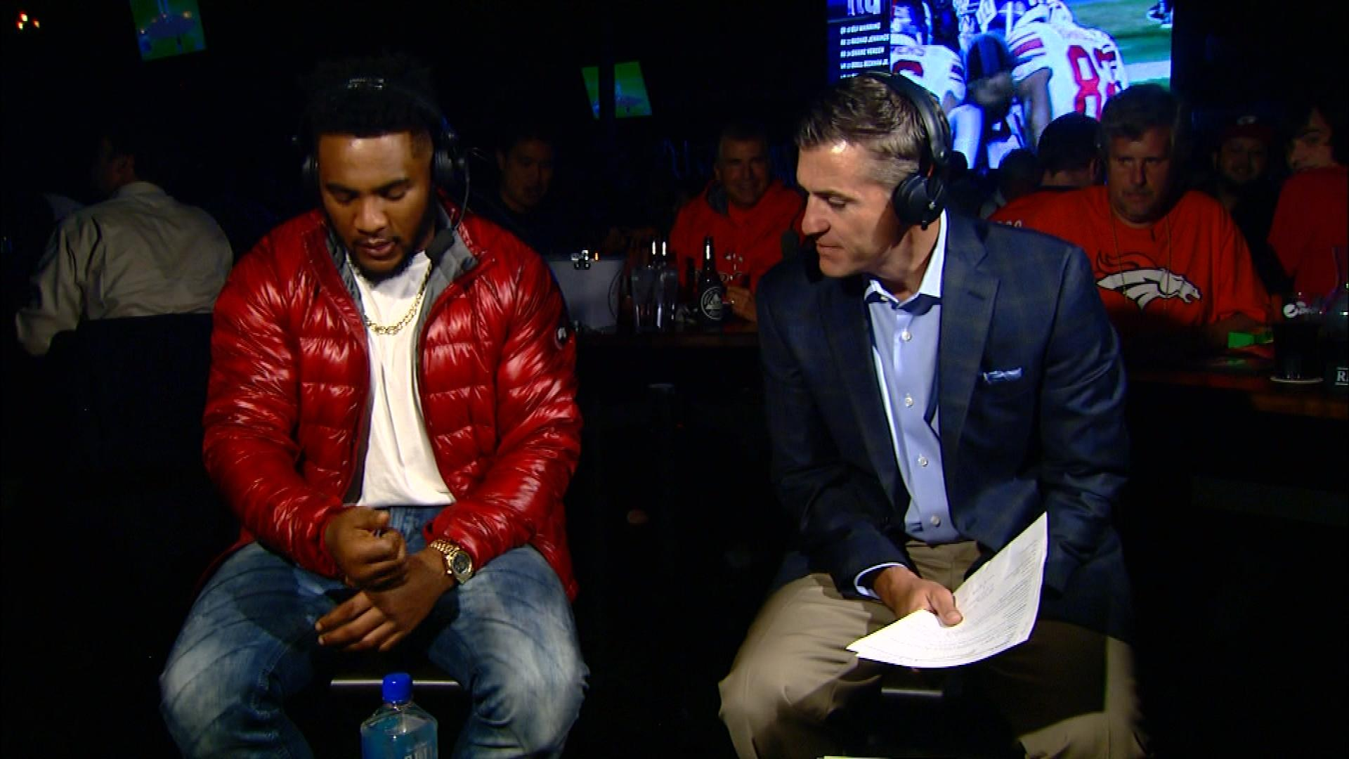 T.J. Ward shows CBS4's Vic Lombardi his swollen hand. (credit: CBS)