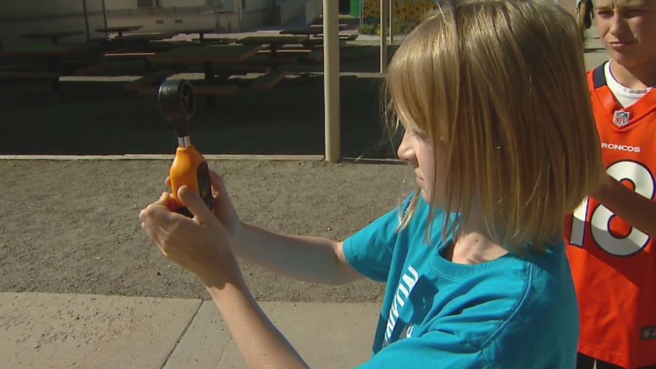 A 5th grader at Bear Canyon Elementary checks the wind as part of the CBS4 Weather Watcher program. (credit: CBS)