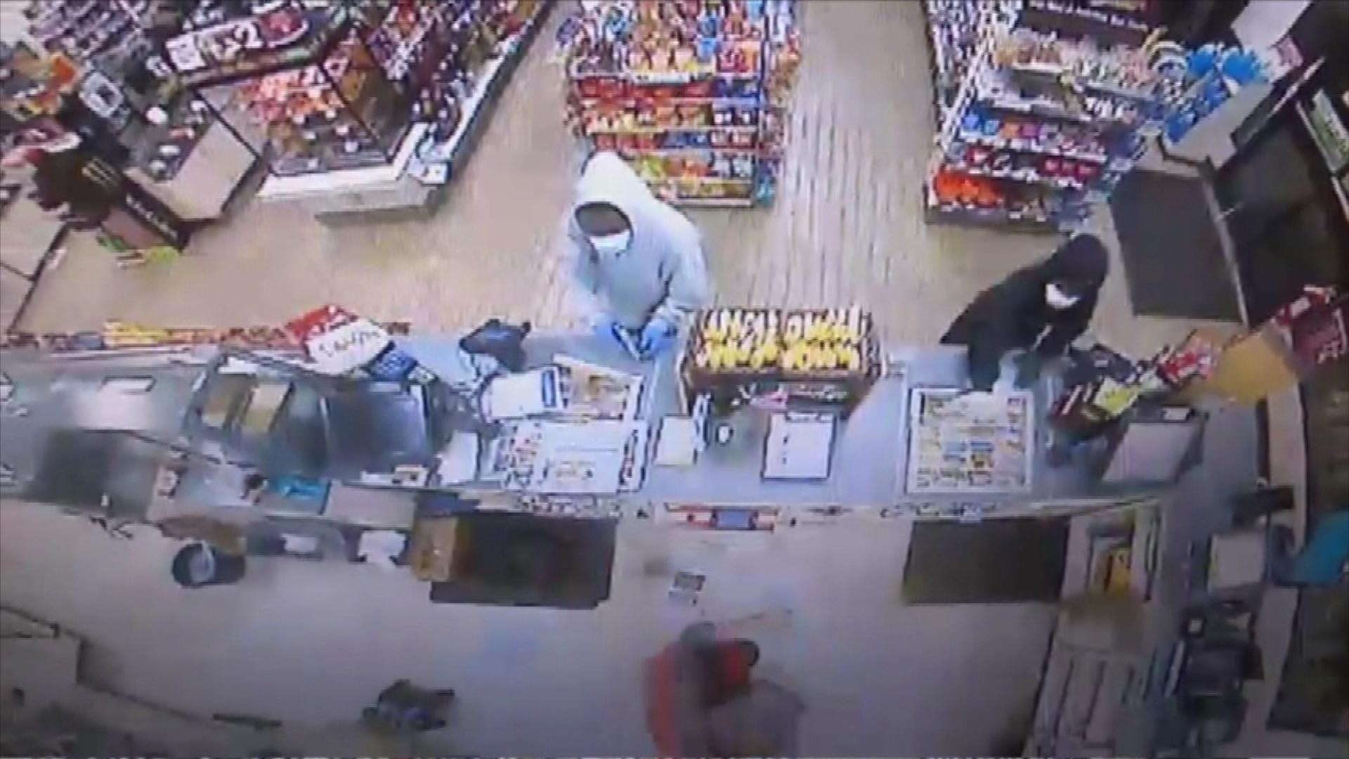 The 7-Eleven robbery at 6th and Josephine (credit: Denver Police Department)