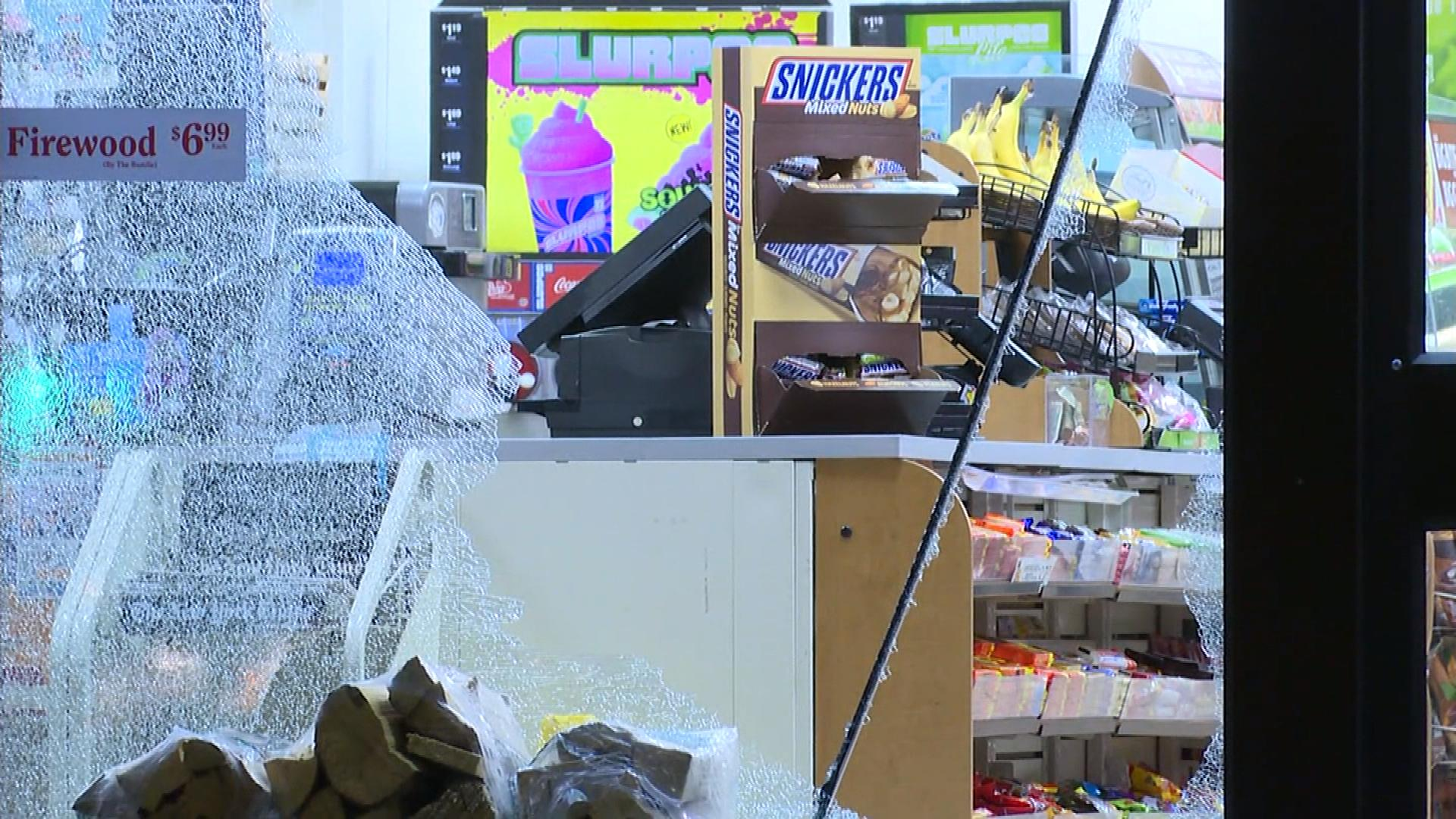 Broken glass from the 7-Eleven robbery at 6th and Josephine (credit: Denver Police Department)