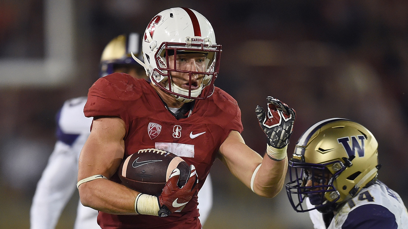 Christian McCaffrey #5 of the Stanford Cardinal's scores a touchdown breaking the tackle of  JoJo McIntosh #14 of the Washington Huskies at Stanford Stadium on Oct. 24, 2015. (credit: Thearon W. Henderson/Getty Images)