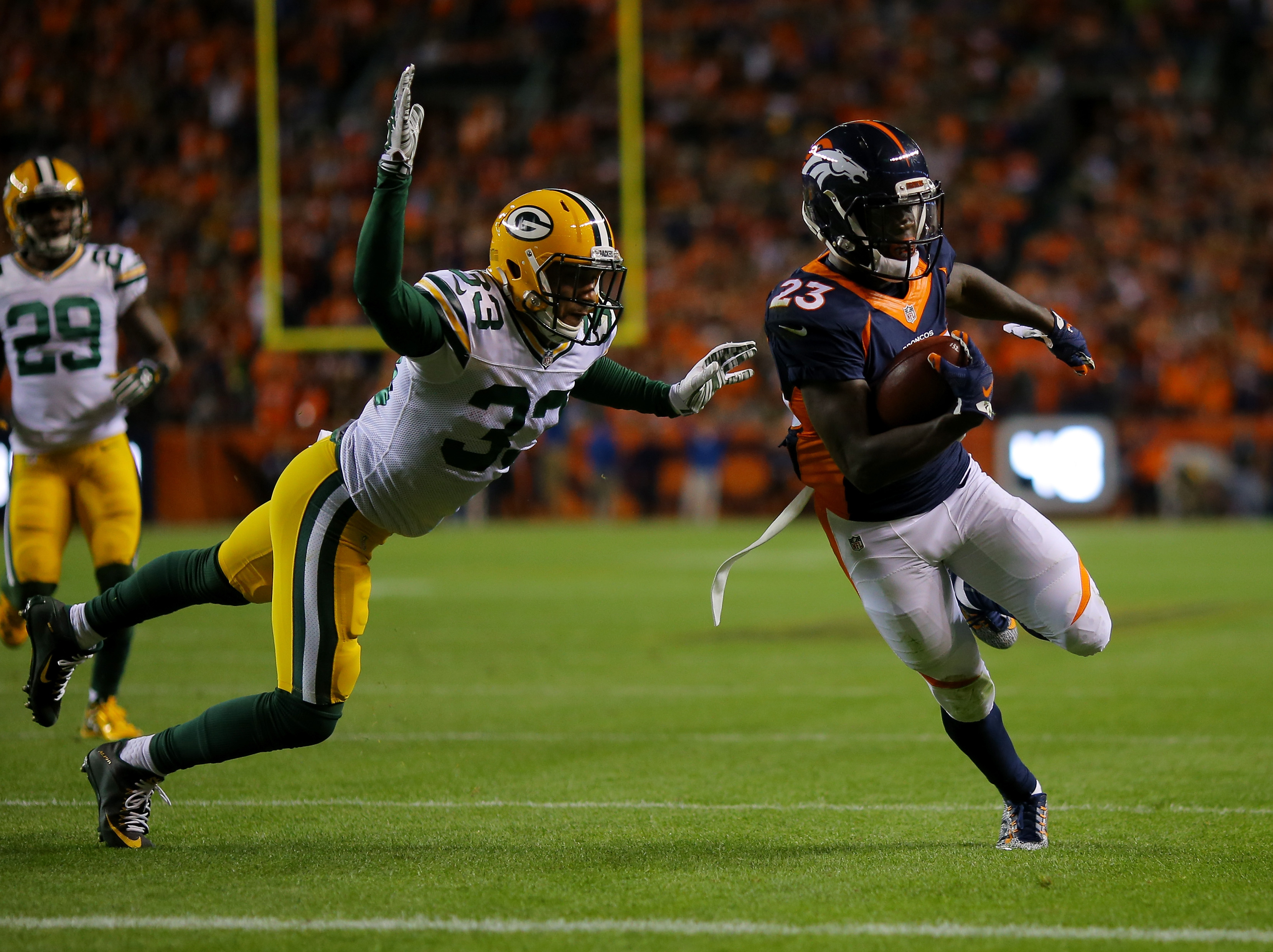 Ronnie Hillman of the Denver Broncos runs in a touchdown against Micah Hyde #33 of the Green Bay Packers in the second quarter at Sports Authority Field at Mile High on November 1, 2015.  (Photo by Justin Edmonds/Getty Images)
