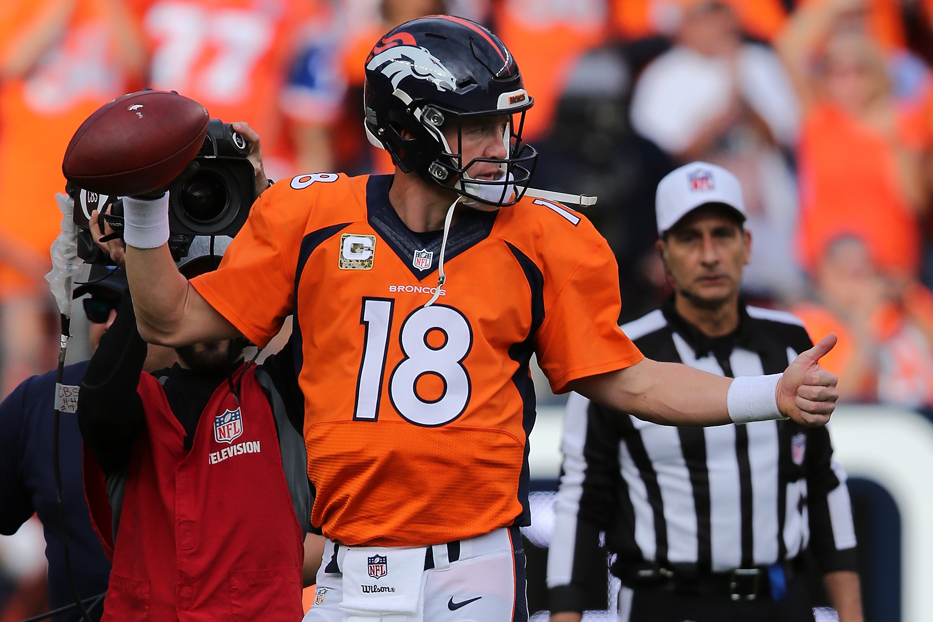 DENVER, CO - NOVEMBER 15: Peyton Manning #18 of the Denver Broncos reacts as he sets the NFL career passing yards record with a four yard completion to Ronnie Hillman #23 of the Denver Broncos against the Kansas City Chiefs in the first quarter at Sports Authority Field at Mile High on November 15, 2015 in Denver, Colorado. Mannning passes Bret Farve who previously heldÊthe record at 71, 838 yards. (Photo by Doug Pensinger/Getty Images)