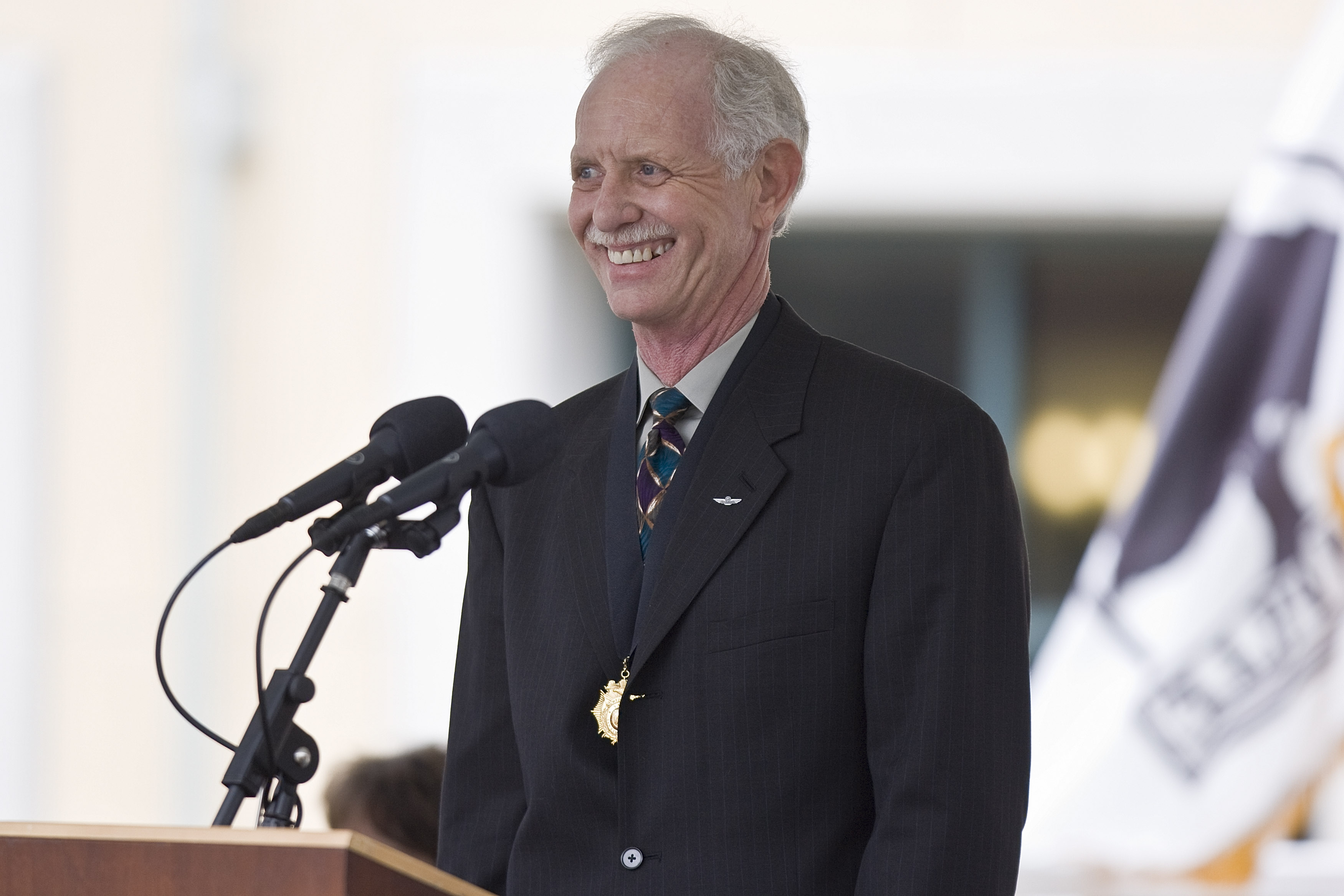 US Airways pilot Sully Sullenberger speaks at a celebration in his honor Jan. 24, 2009 in Danville, California. Sullenberger was honored for guiding his crippled airliner to safe landing in the Hudson River, saving the lives of all 155 on board on Jan. 15, 2009.  (Photo by David Paul Morris/Getty Images)