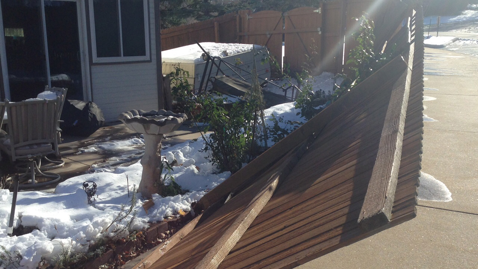 A fence blown down in Golden (credit: CBS)