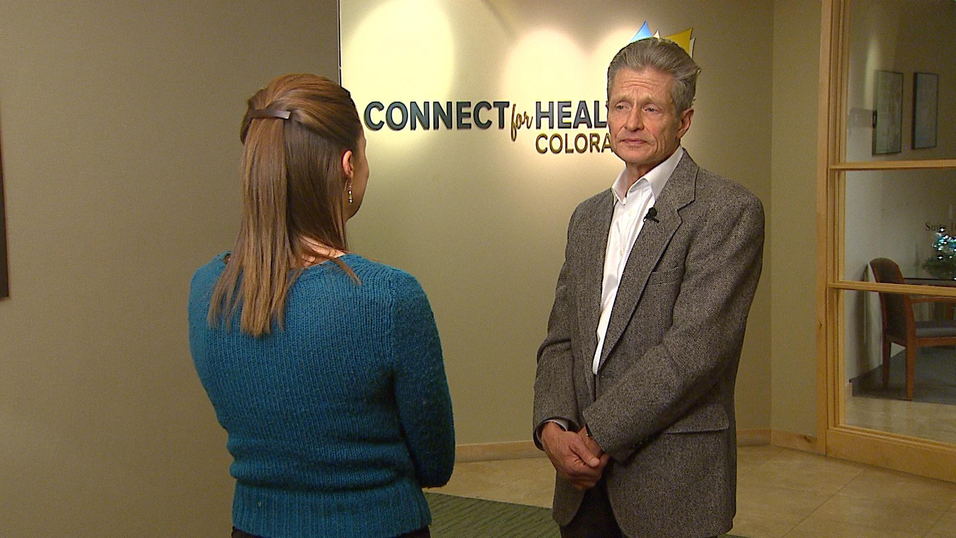 CBS4's Melissa Garcia interviews Luke Clarke with Connect for Health Colorado (credit: CBS)