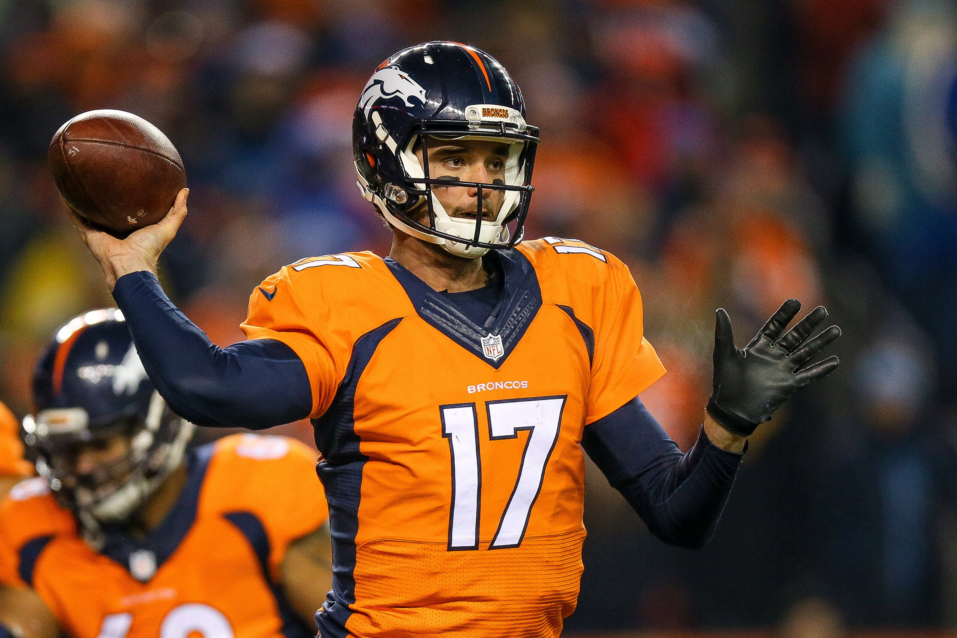 Quarterback Brock Osweiler #17 of the Denver Broncos passes against the Cincinnati Bengals during a game at Sports Authority Field at Mile High on December 28, 2015 in Denver, Colorado. (Photo by Justin Edmonds/Getty Images)