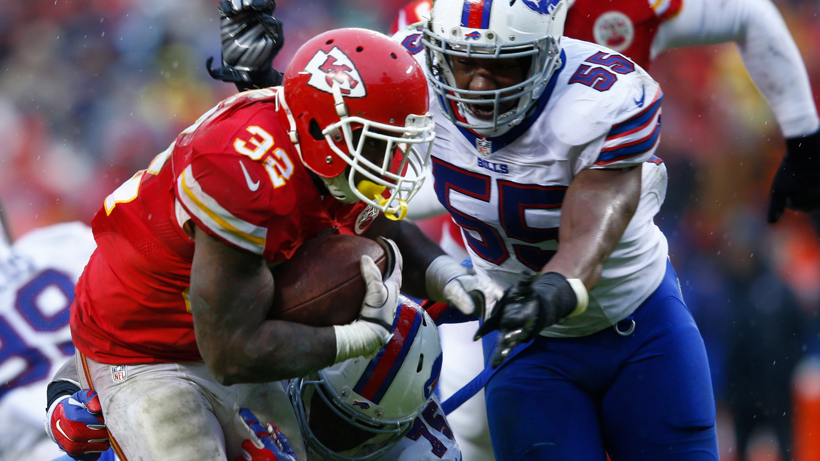 Spencer Ware of the Kansas City Chiefs is tackled by Jerry Hughes #55 of the Buffalo Bills at Arrowhead Stadium on Nov. 29, 2015. (credit: Jamie Squire/Getty Images)