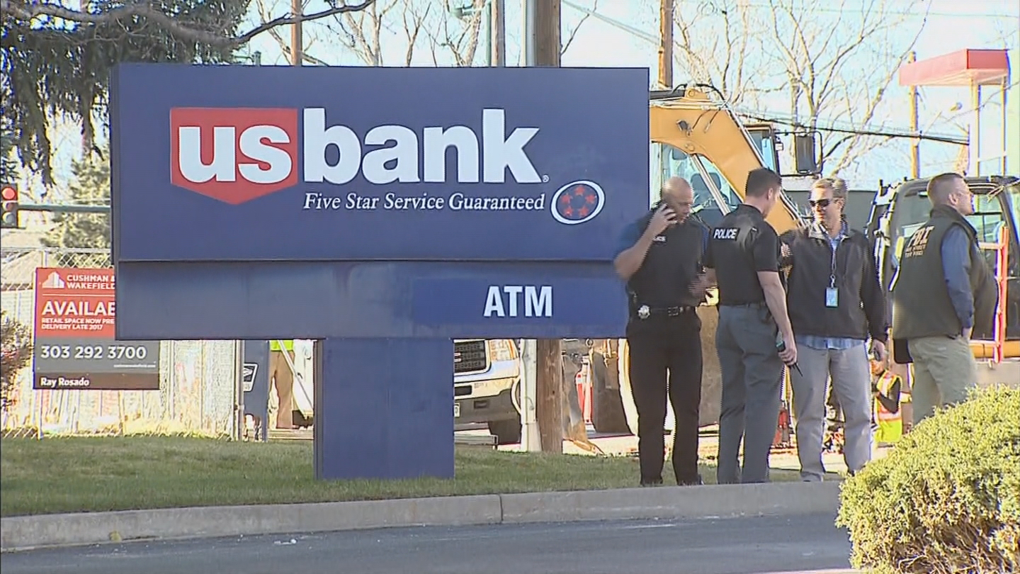 Police investigate a car jacking on W. 38th Ave. outside the UBBank. (credit: CBS)