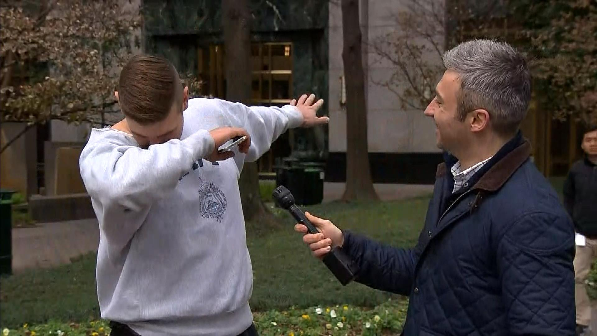 """A Panthers fan doing """"The Dab"""" (credit: CBS)"""