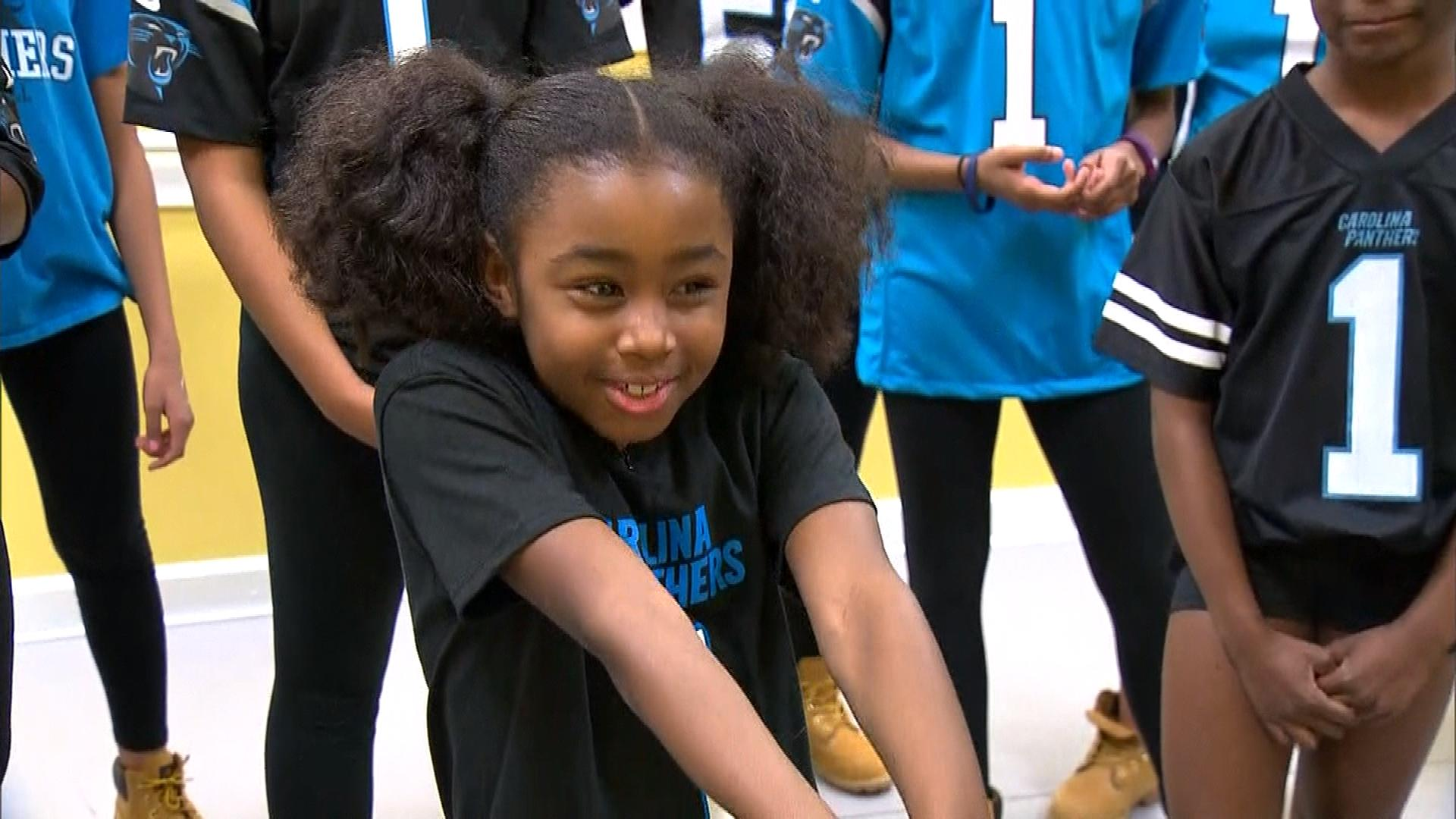 """A young Panthers fan talks about doing """"The Dab"""" (credit: CBS)"""