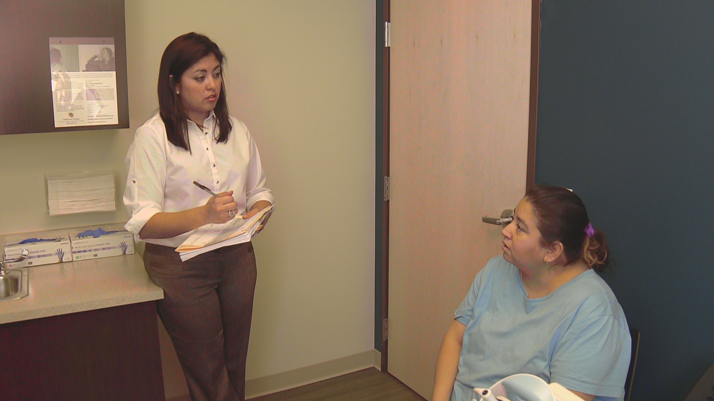 CU Healthcare Partners clinic operations manager Adrienne Wolf questions Rose Urbina (credit: CBS)
