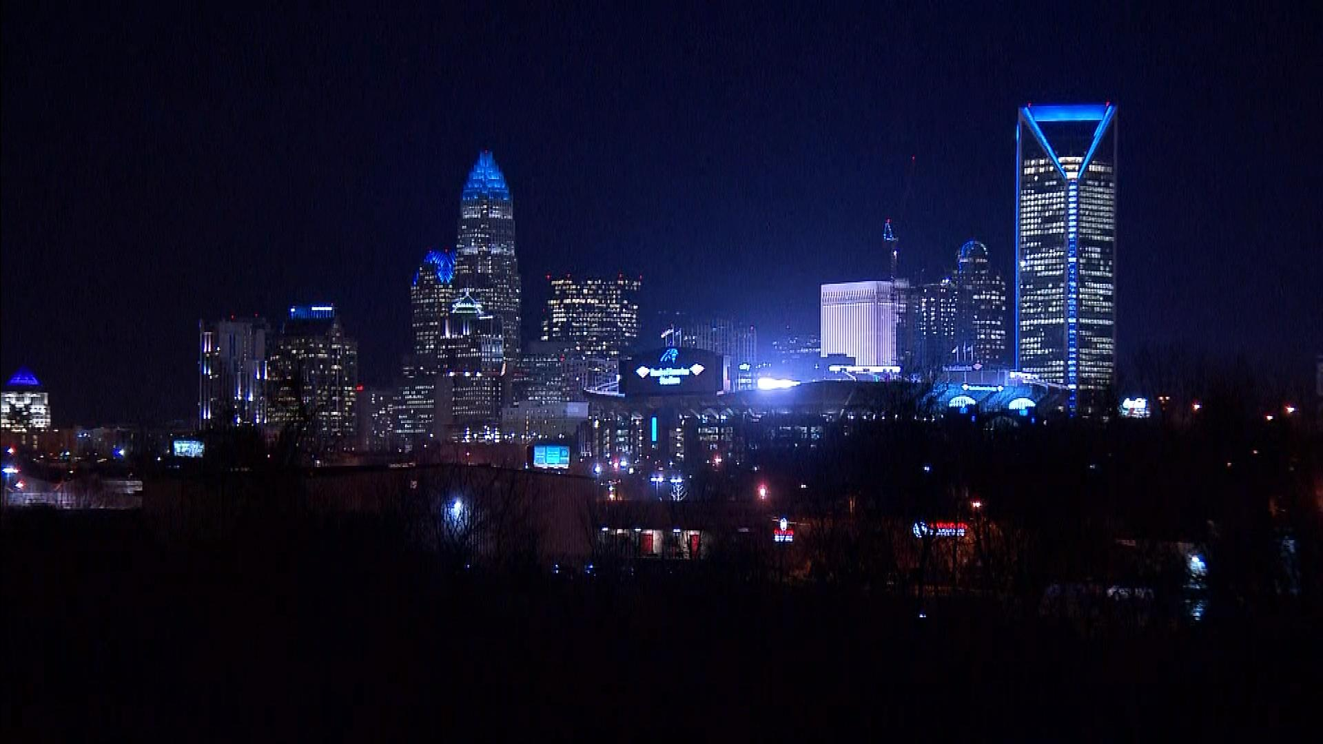 Charlotte lit up in Panther blue at night (credit; CBS)