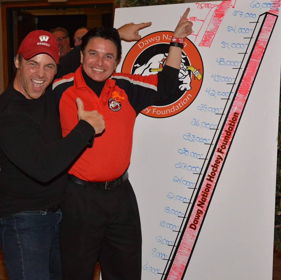 Dawg Nation board member Todd Gehrke with president Martin Richardson at Repsher Fundraiser (credit: CBS)