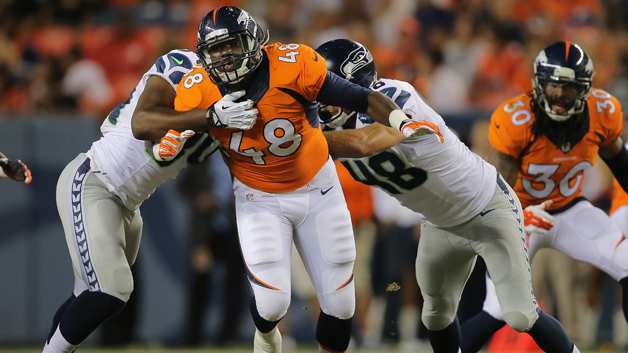 DENVER, CO - AUGUST 07: Linebacker Shaquil Barrett #48 of the Denver Broncos rushes against the Seattle Seahawks during preseason action at Sports Authority Field at Mile High on August 7, 2014 in Denver, Colorado. The Broncos defeated the Seahawks 21-16. (Photo by Doug Pensinger/Getty Images)