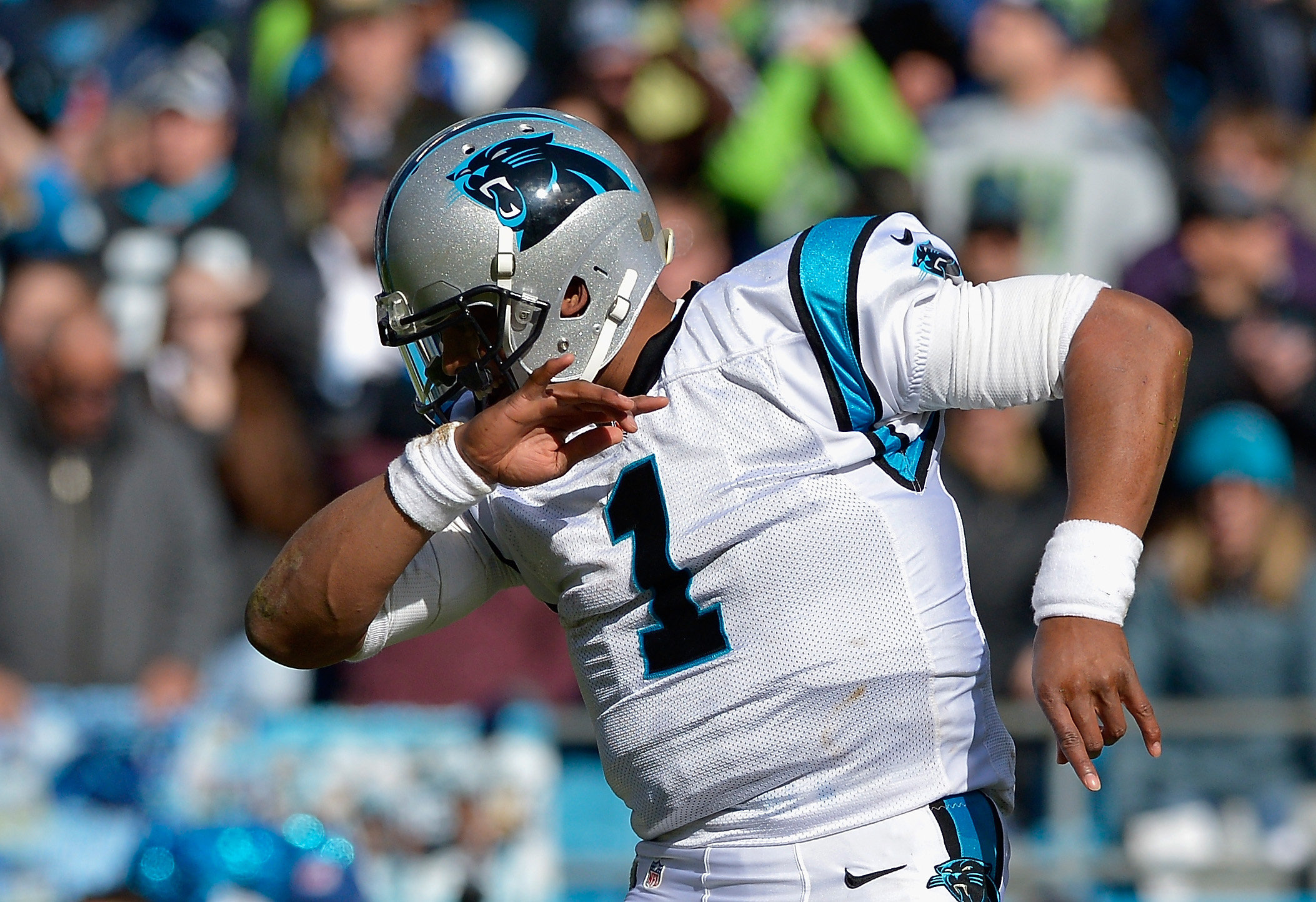 """Cam Newton #1 of the Carolina Panthers shows his trademark """"Dab"""" against the Seattle Seahawks in the 2nd quarter during the NFC Divisional Playoff Game at Bank of America Stadium on January 17, 2016 in Charlotte, North Carolina. (Photo by Grant Halverson/Getty Images)"""